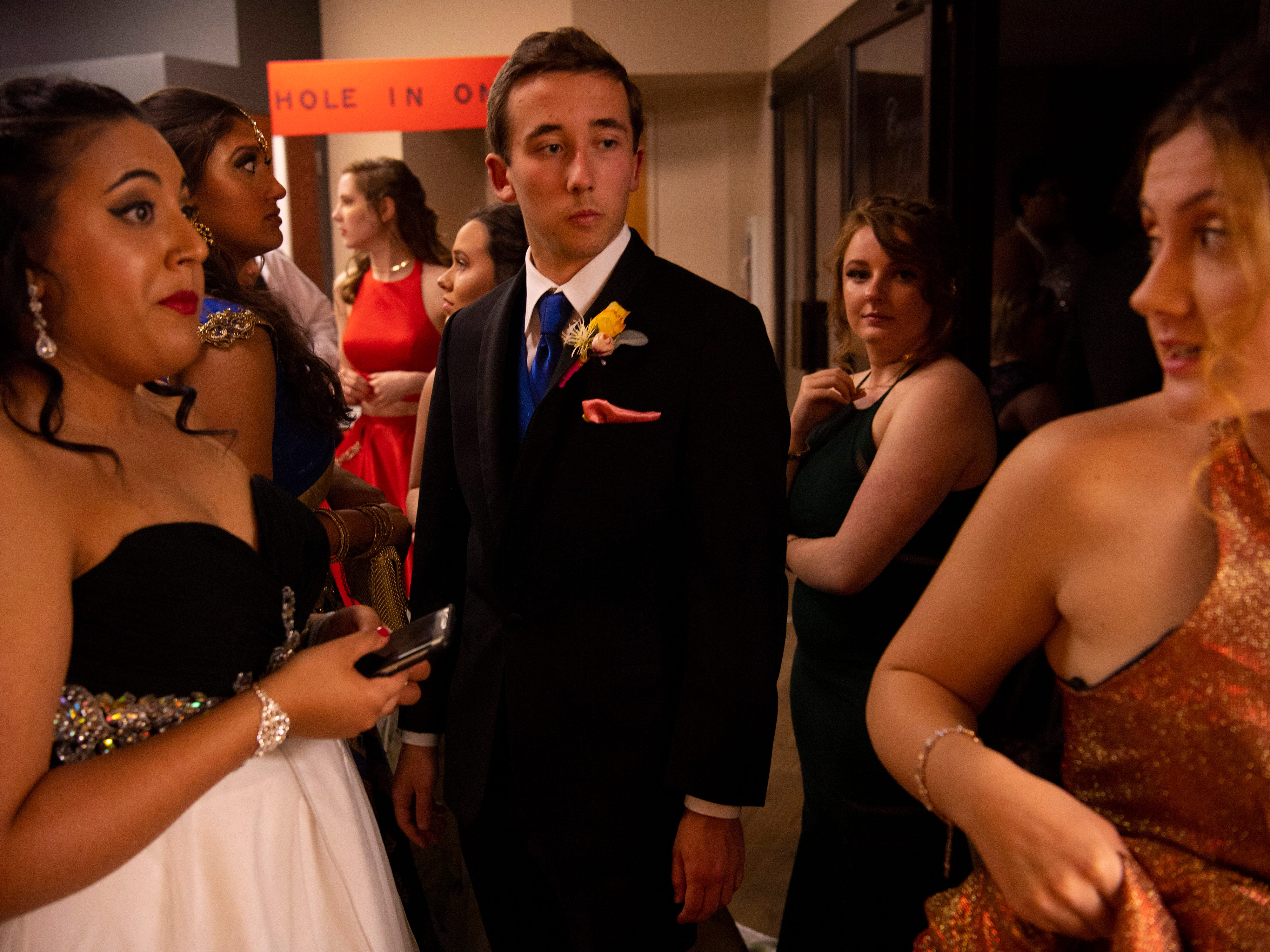 """The line for checking coats, bags and shoes gathers outside the coat check at """"The Greatest Prom on Earth"""" at Milestones Saturday night."""