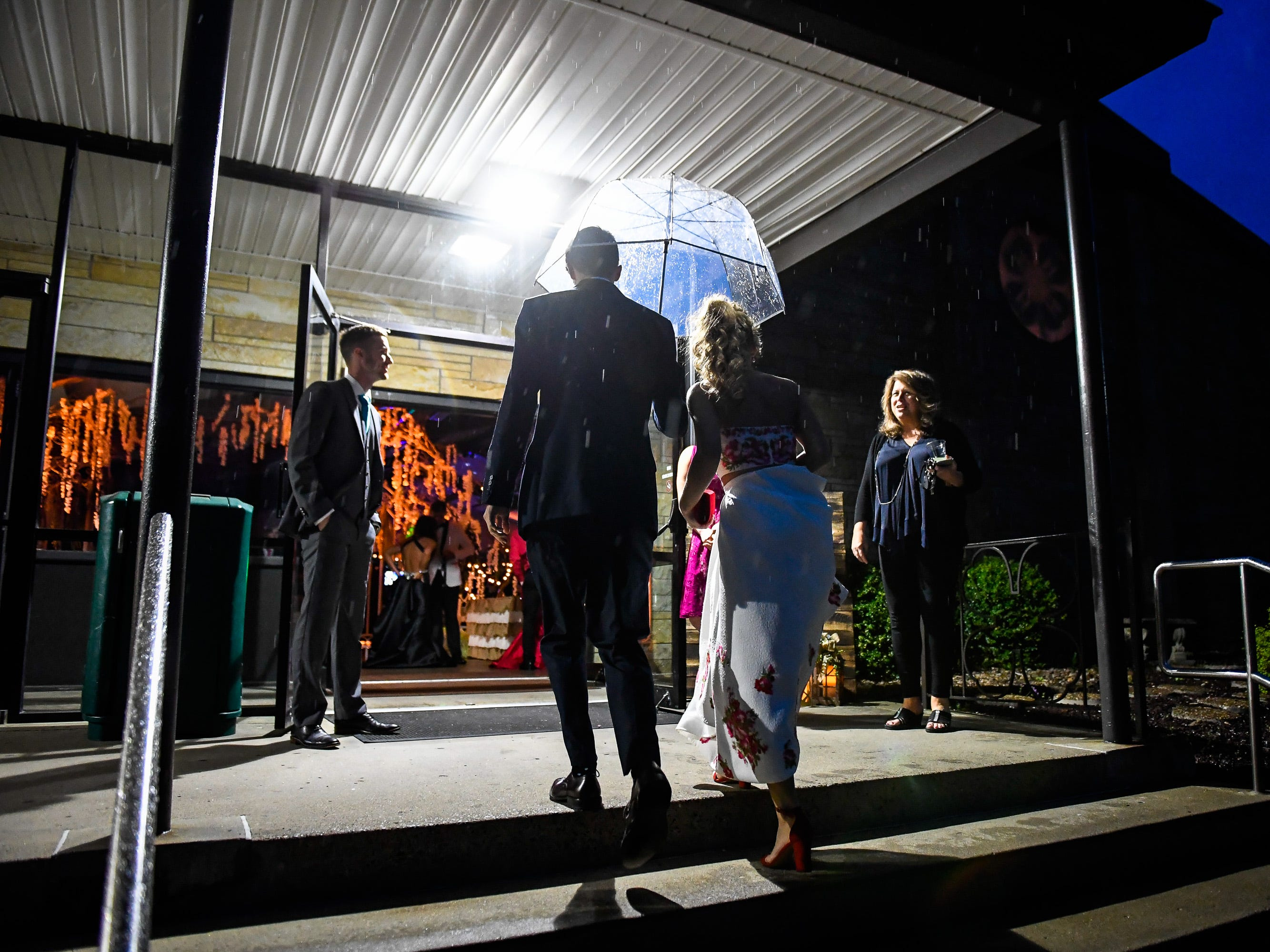 Couples arriving in the rain at the Reitz High School Prom held at the Vanderburgh 4-H Center Saturday, April 13, 2019.