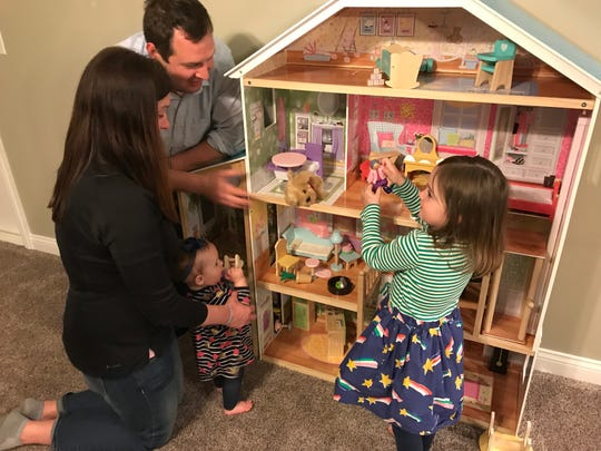 Mark and Allison Royer play with their daughters Louisa, 4, and Catherine, 1.