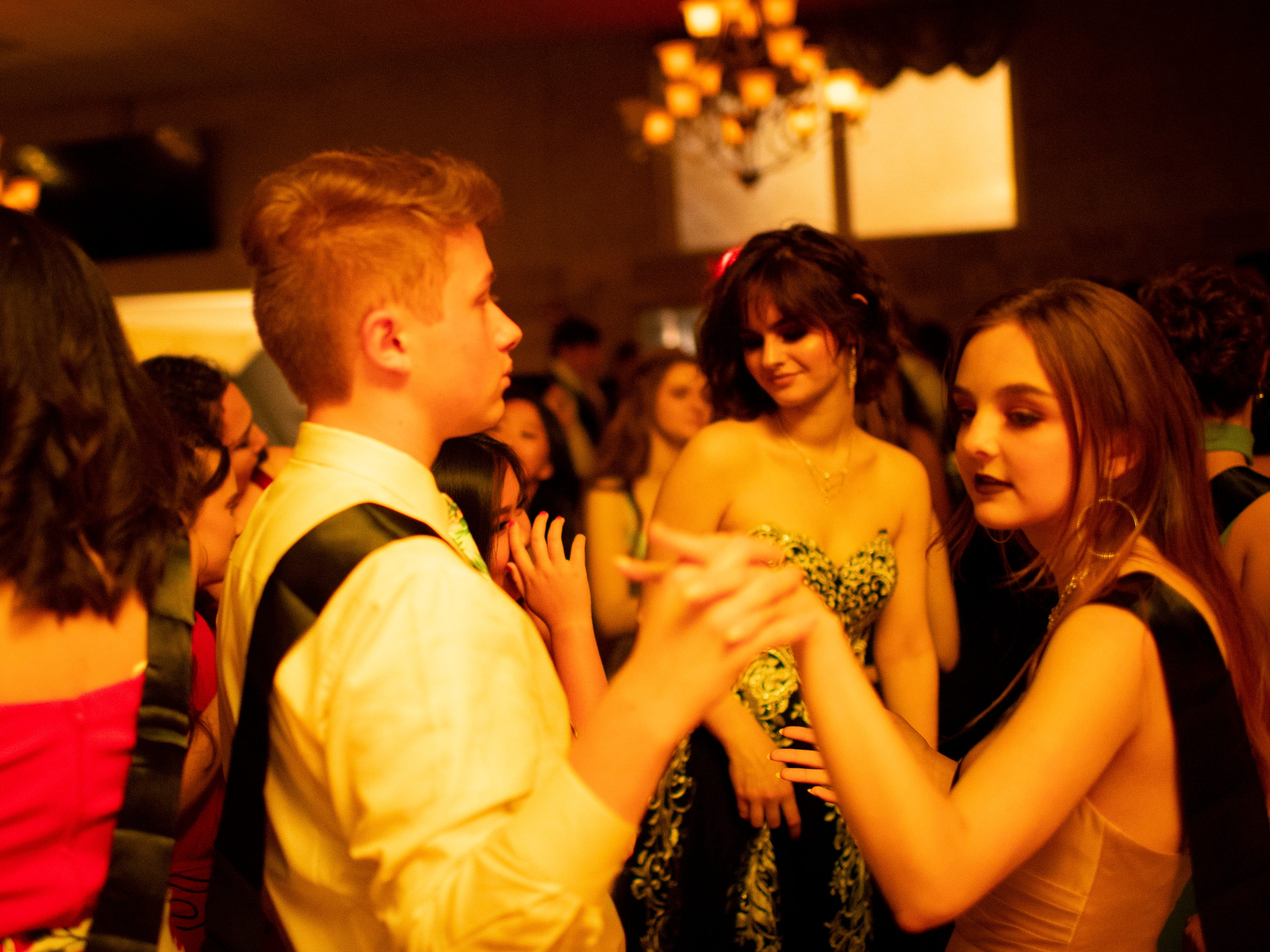 """Signature School students Jack Watson, 16, left, and Laine Kennedy, 17, dance at """"Jurassic Prom"""" at Party Central Saturday night."""