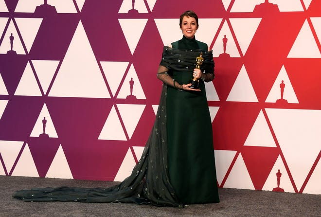 Olivia Colman receiving Actress in a Leading Role award at the 2019 Oscars.
