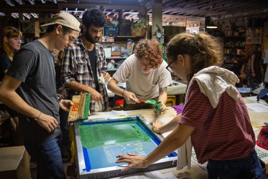 Will Harrison (left) is a graduating senior of the FSU College of Motion Picture Arts who enjoys dabbling in all kinds of creative endeavors. He found himself at The Plant on Saturday, April 13th to learn the art of screen printing from members of the FSU Print Club.