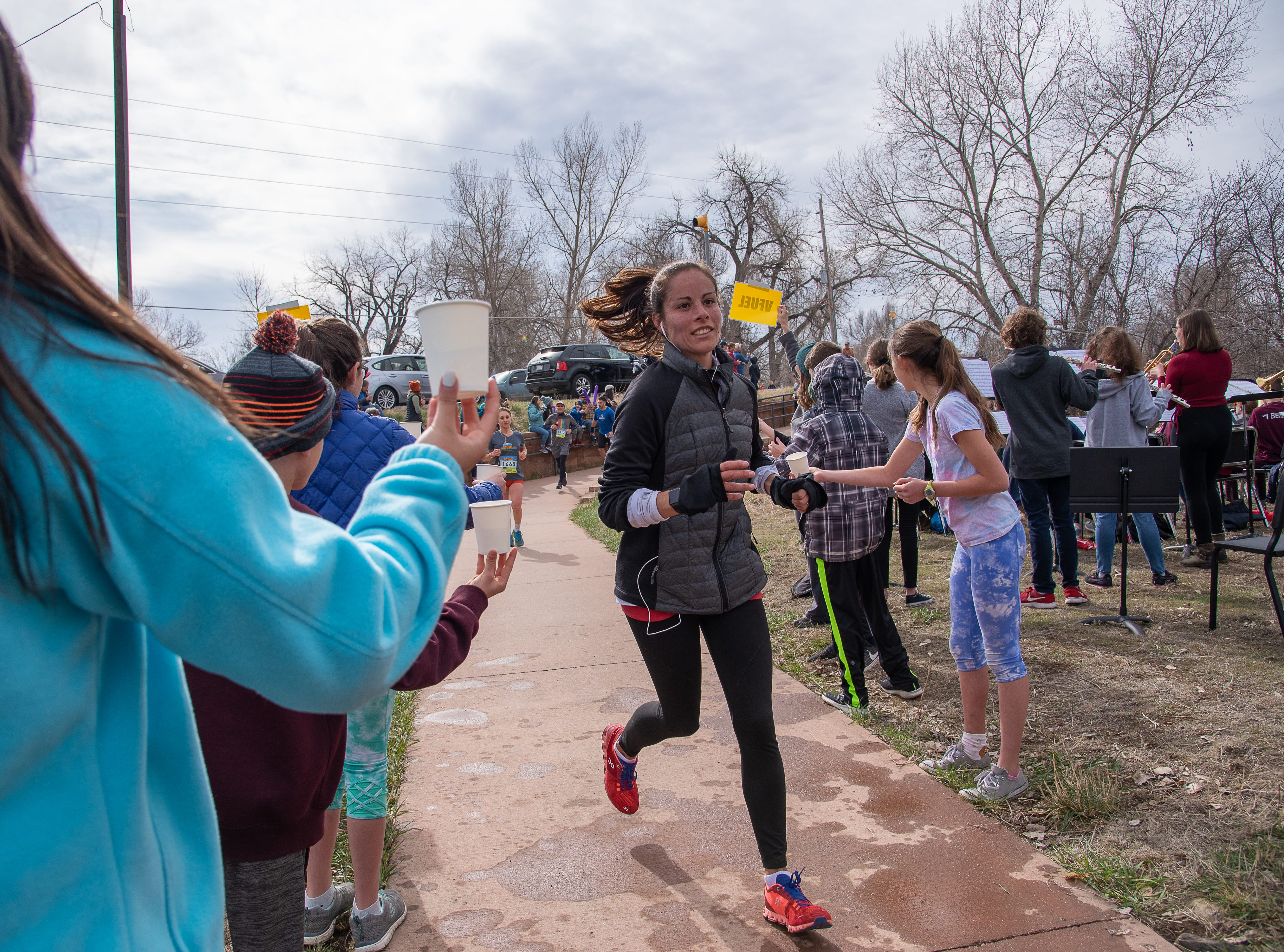Participants enter Lyons Park during the Horsetooth Half Marathon on Sunday, April 14, 2019, in Fort Collins, Colo.