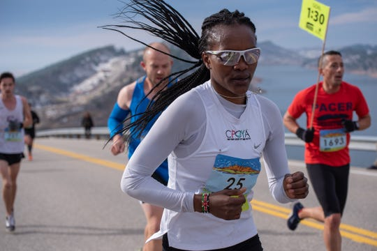 Grace Kahura leads a group of runners near the top of Monster Mountain along Horsetooth Reservoir during the Horsetooth Half Marathon on Sunday, April 14 2019, in Fort Collins, Colo. She finished second among the women at 1:23.10