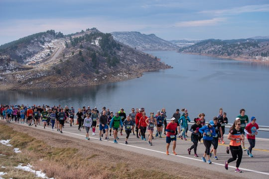 Participants climb Monster Mountain along Horsetooth Reservoir during the Horsetooth Half Marathon on Sunday, April 14, 2019, in Fort Collins, Colorado.