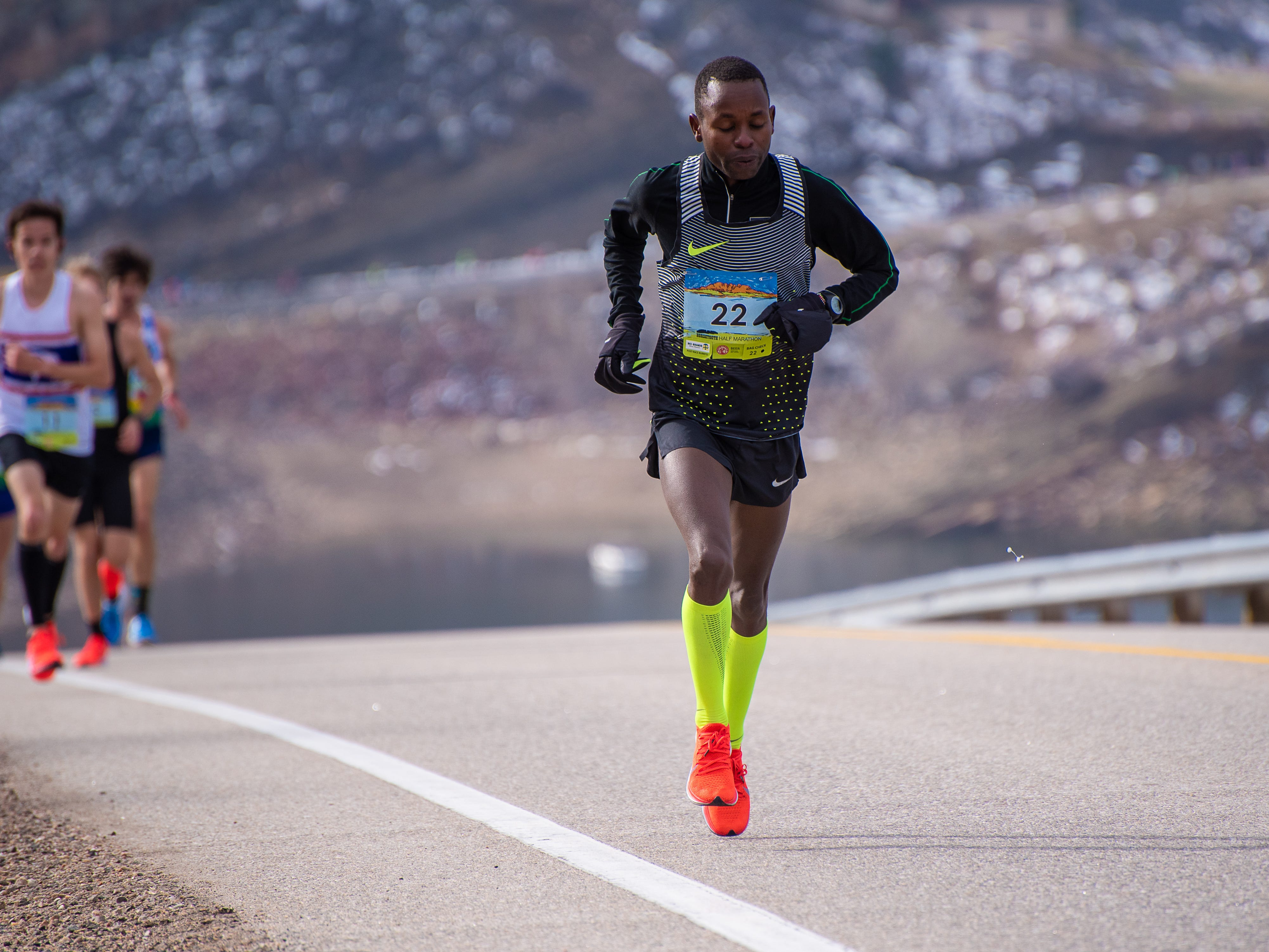 An elite runner nears the top of Monster Mountain along Horsetooth Reservoir during the Horsetooth Half Marathon on Sunday, April 14 2019, in Fort Collins, Colo.