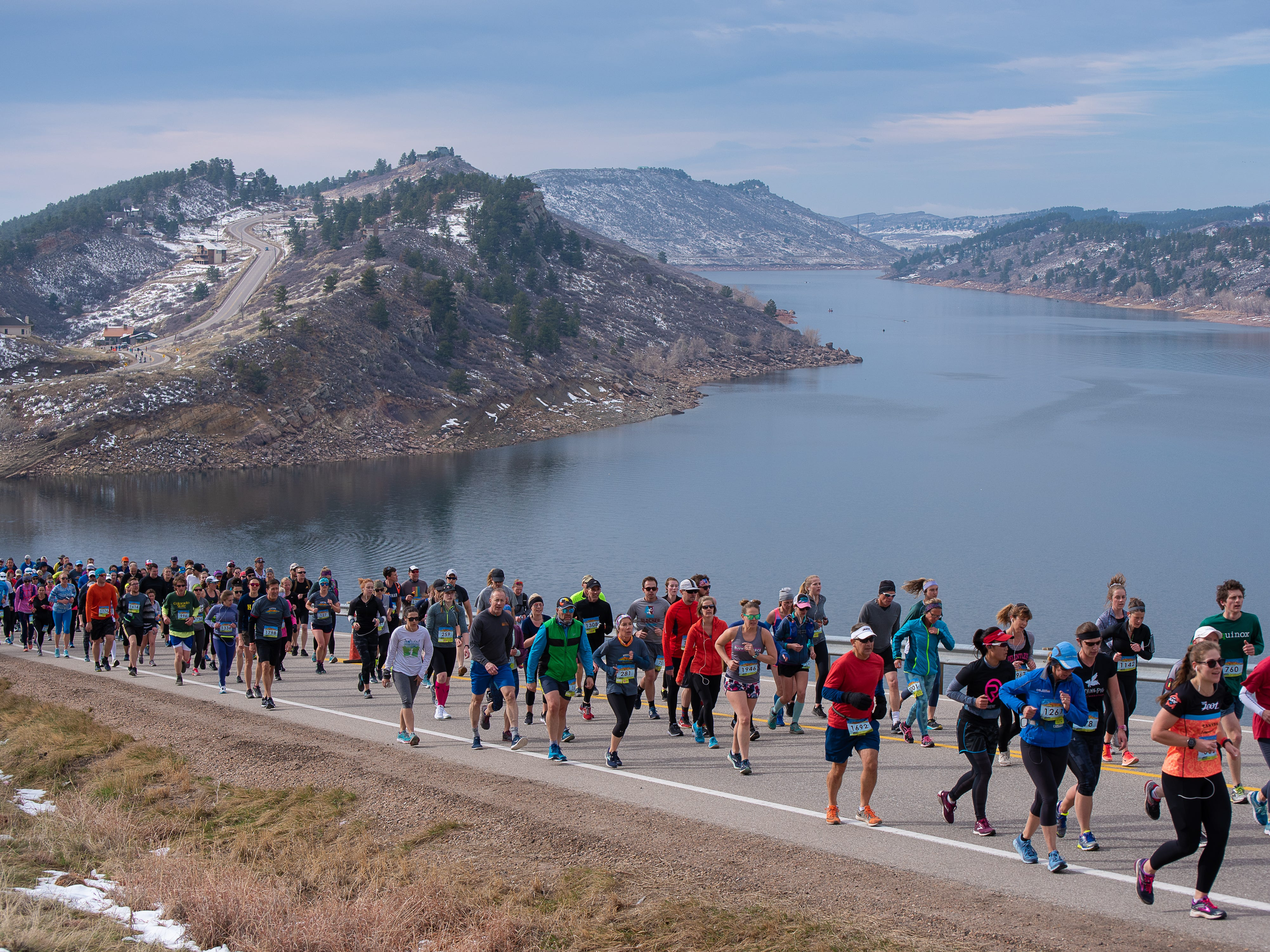 Participants climb Monster Mountain along Horsetooth Reservoir during the Horsetooth Half Marathon on Sunday, April 14, 2019, in Fort Collins, Colo.