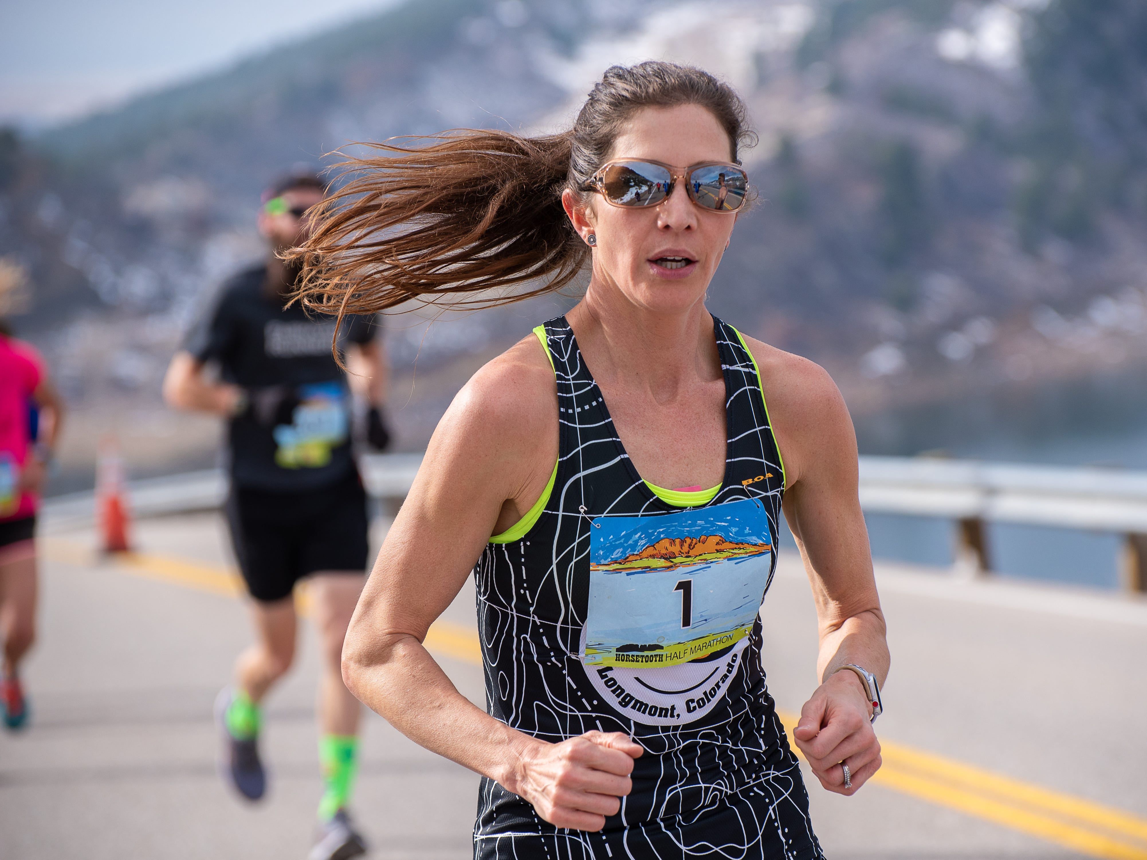 A group of runners near the top of Monster Mountain along Horsetooth Reservoir during the Horsetooth Half Marathon on Sunday, April 14 2019, in Fort Collins, Colo.