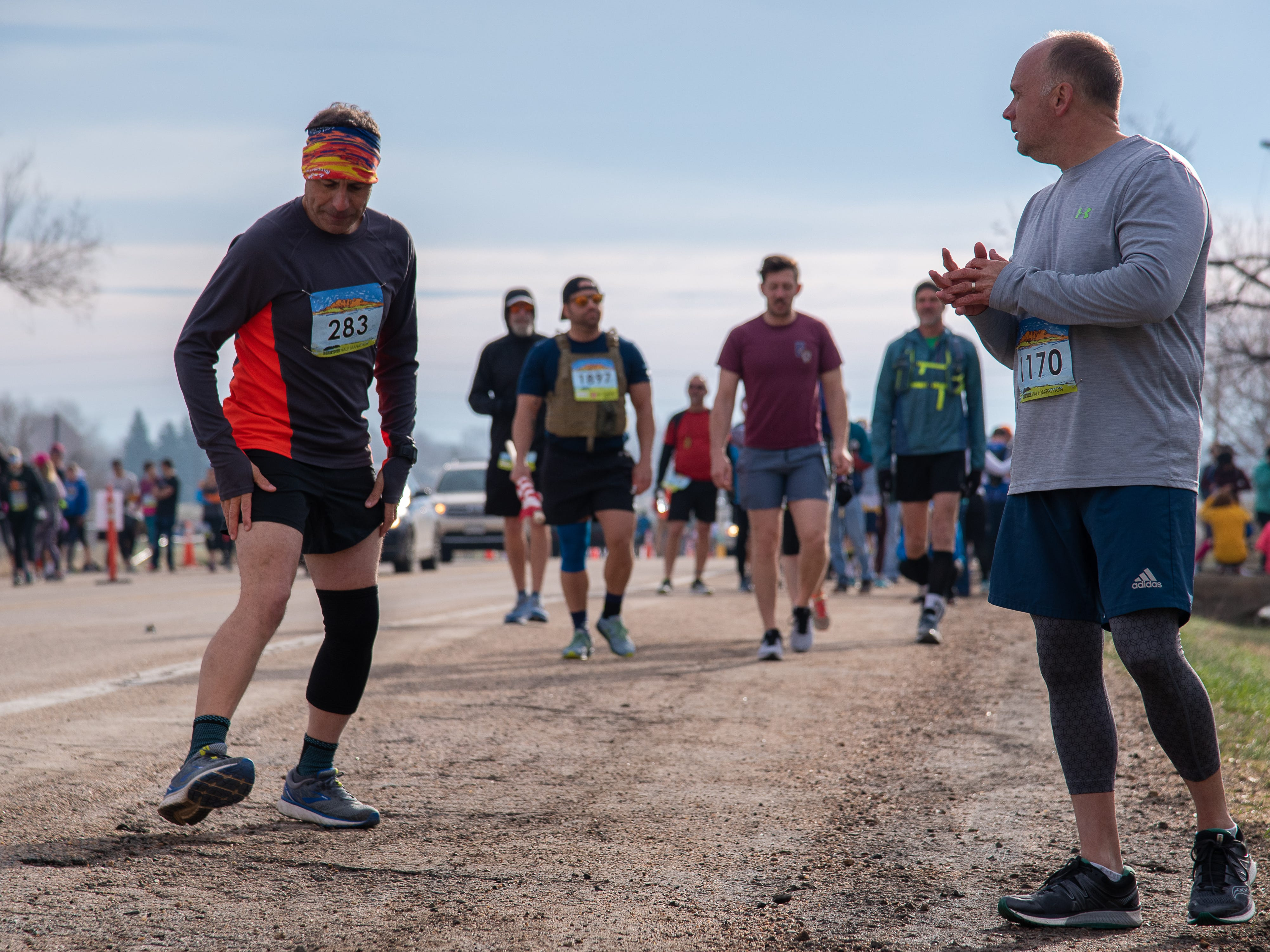 Participants limber up before the start of the Horsetooth Half Marathon on Sunday, April 14, 2019, in Fort Collins, Colo.