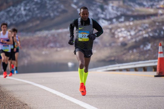 Dominic Korir nears the top of Monster Mountain along the Horsetooth Reservoir during the Horsetooth Half Marathon on Sunday, April 14 2019, in Fort Collins, Colorado. He went on to win the race in 1:07.34.