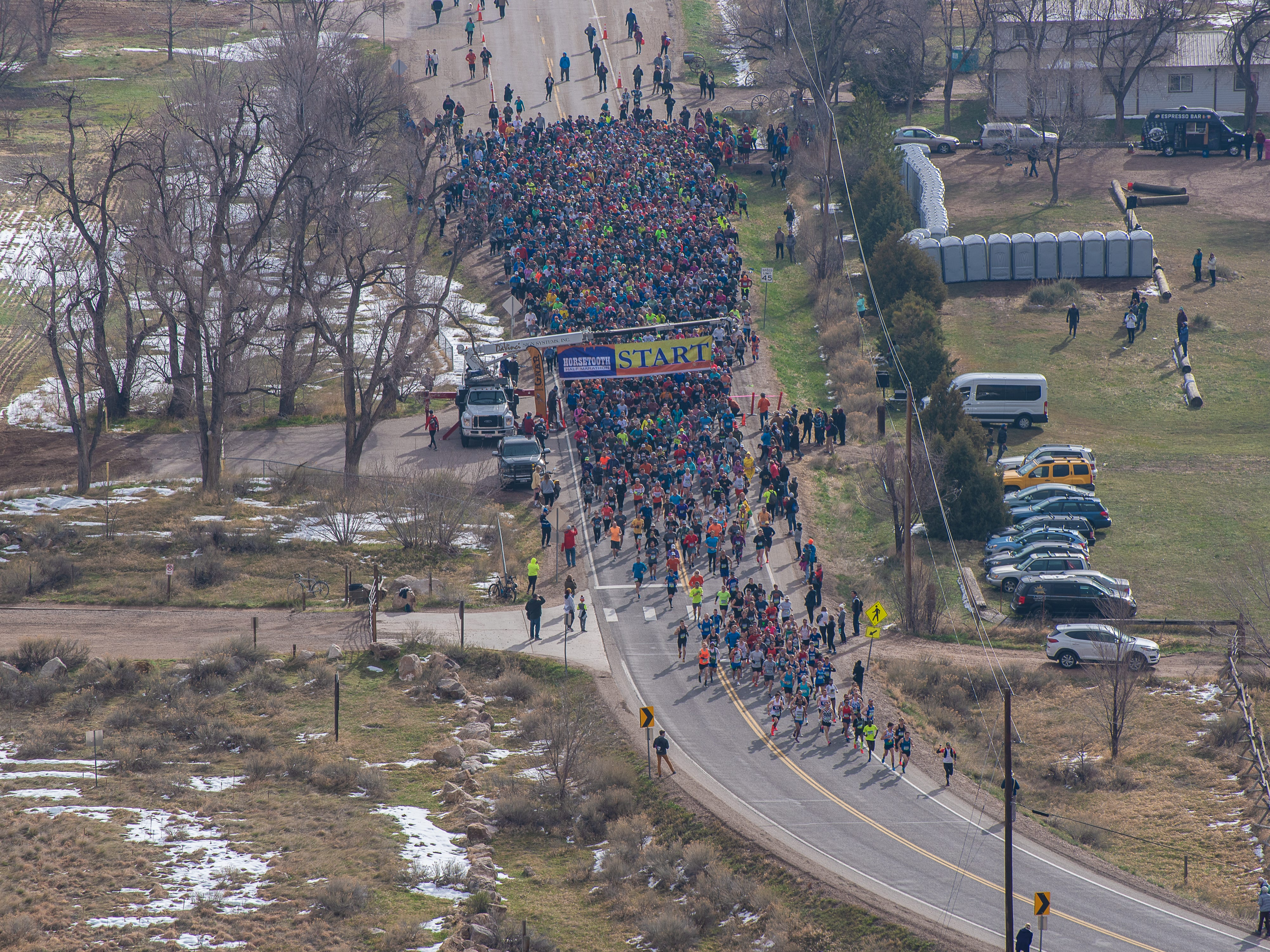 Participants take off from the start line during the Horsetooth Half Marathon on Sunday, April 14, 2019, in Fort Collins, Colo.