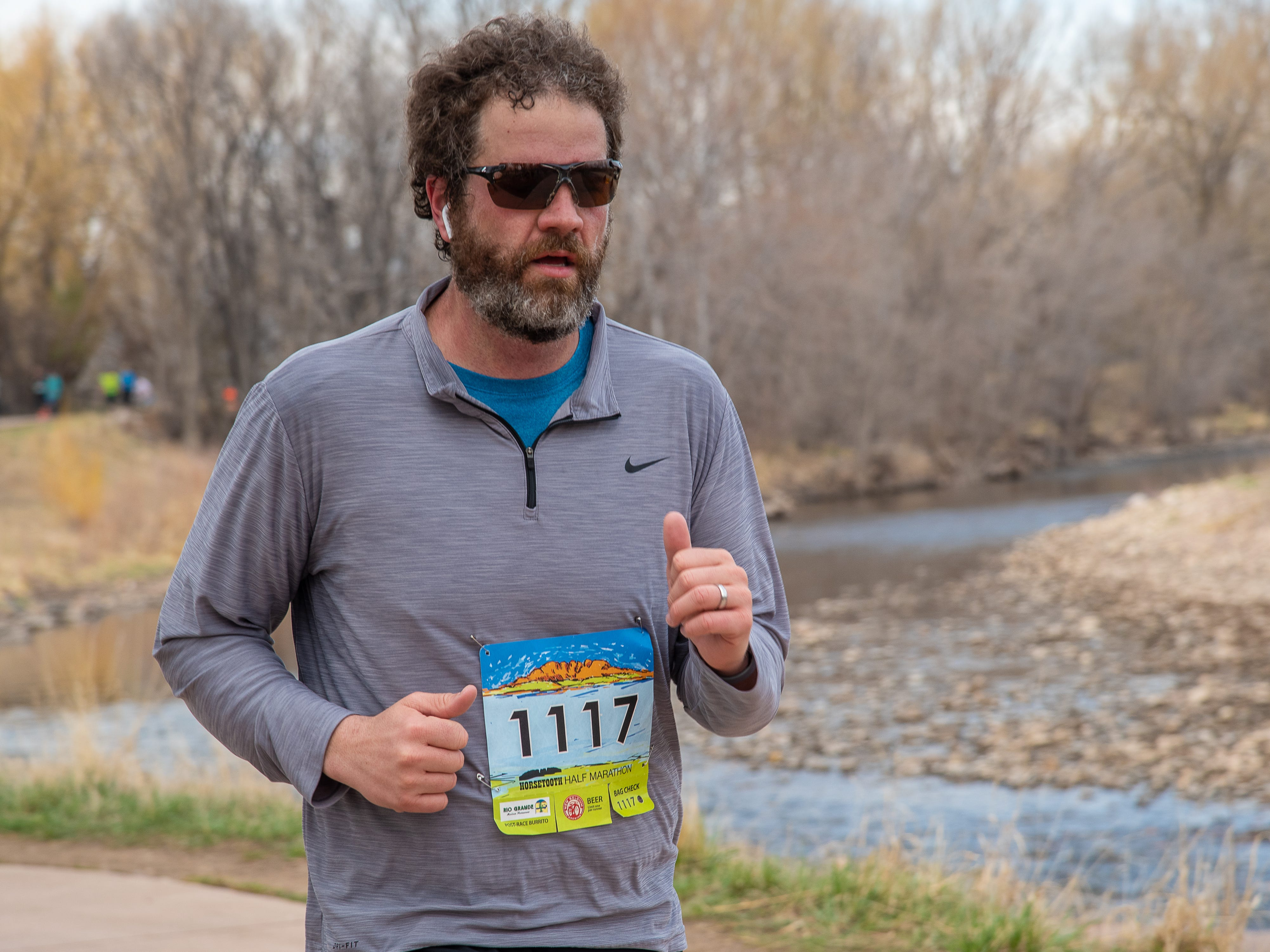 A participant runs on the Poudre Trail near Wood Street during the Horsetooth Half Marathon on Sunday, April 14, 2019, in Fort Collins, Colo.