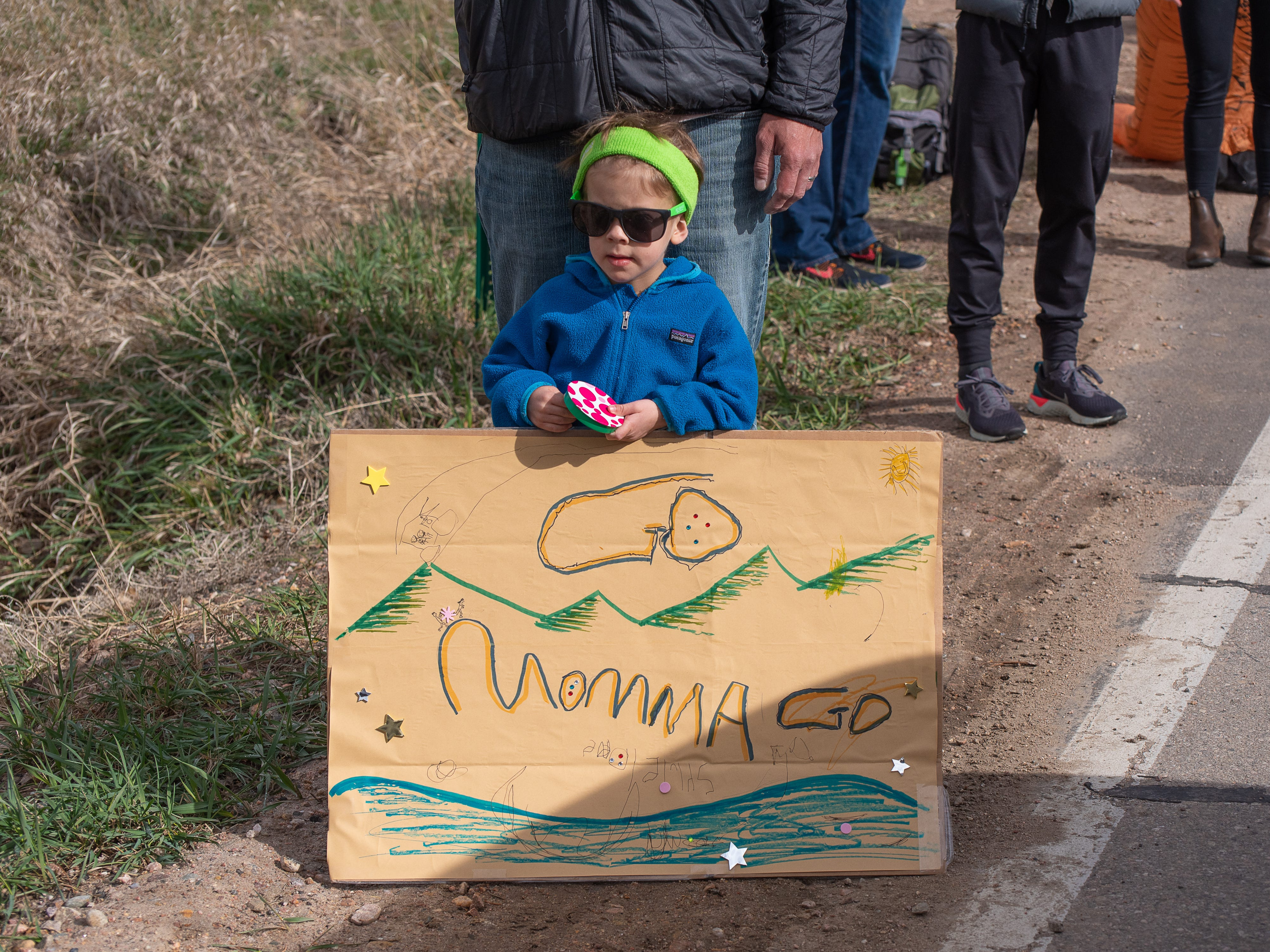 A young spectator holds a sign of encouragement near Bellvue during the Horsetooth Half Marathon on Sunday, April 14, 2019, in Fort Collins, Colo.