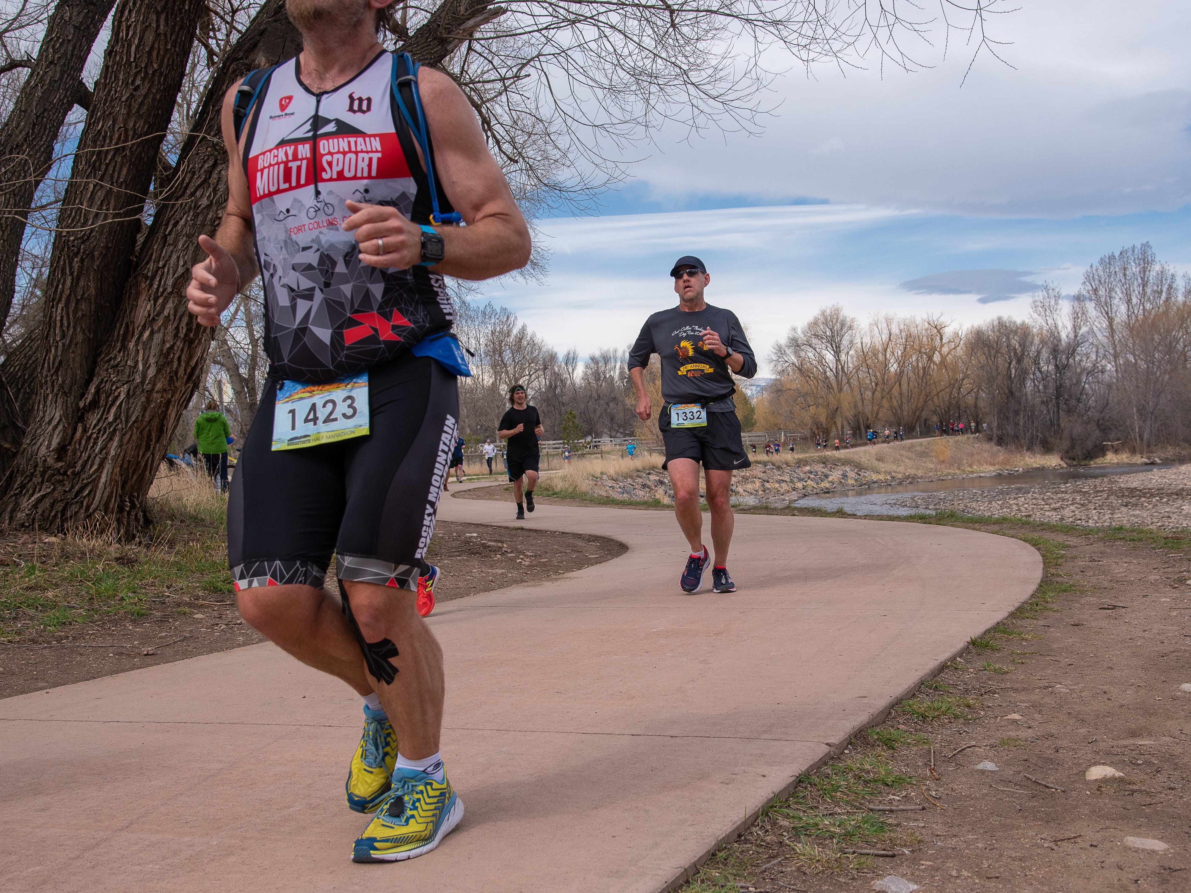 Participants run on the Poudre Trail near Wood Street during the Horsetooth Half Marathon on Sunday, April 14, 2019, in Fort Collins, Colo.