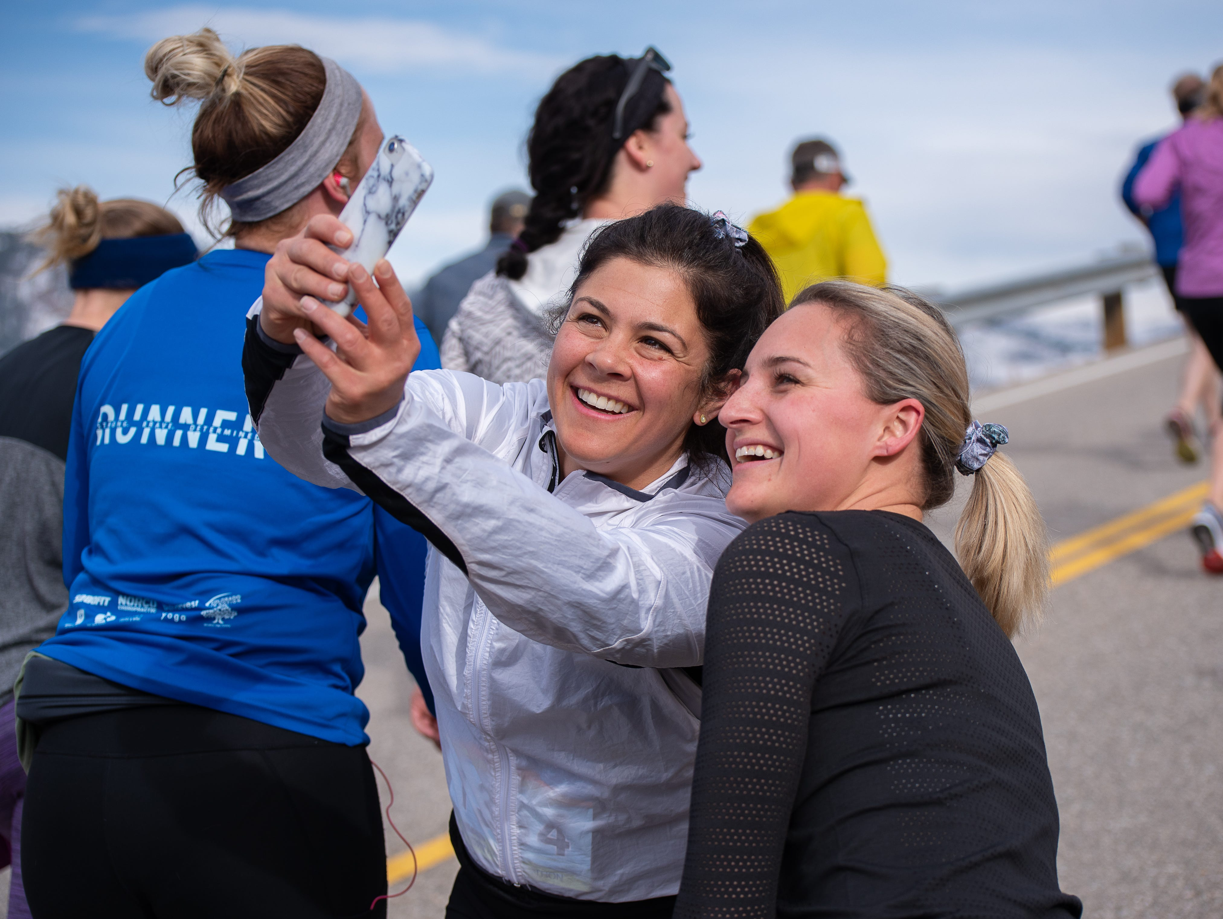 Two women pause near the top of Monster Mountain to take a selfie during the Horsetooth Half Marathon on Sunday, April 14, 2019, in Fort Collins, Colo.