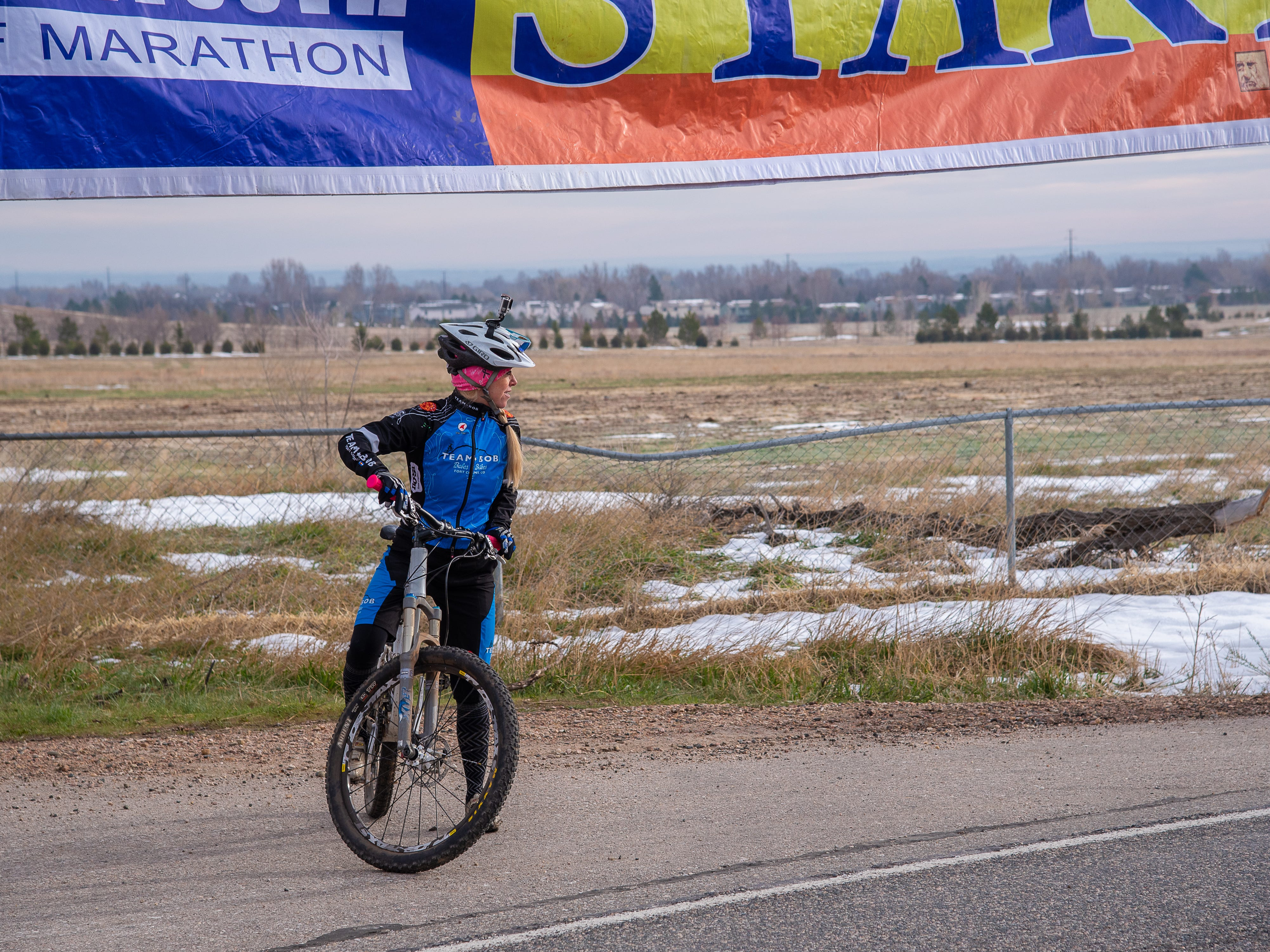 Kimber Korsgaard, bike lead for women participants in the Horsetooth Half Marathon, prepares to start the course on Sunday, April 14, 2019, in Fort Collins, Colo.