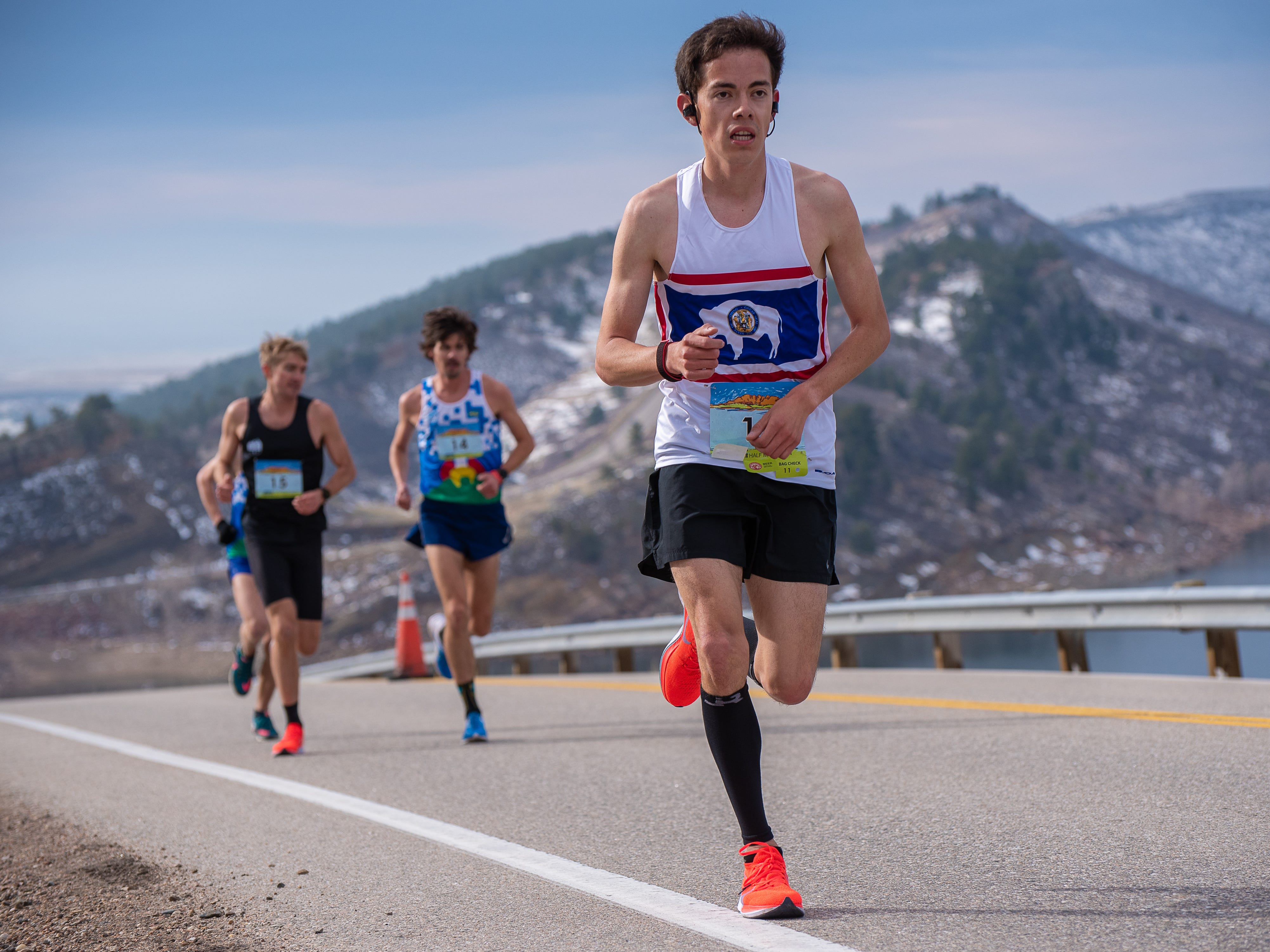Elite runners near the top of Monster Mountain along Horsetooth Reservoir during the Horsetooth Half Marathon on Sunday, April 14 2019, in Fort Collins, Colo.