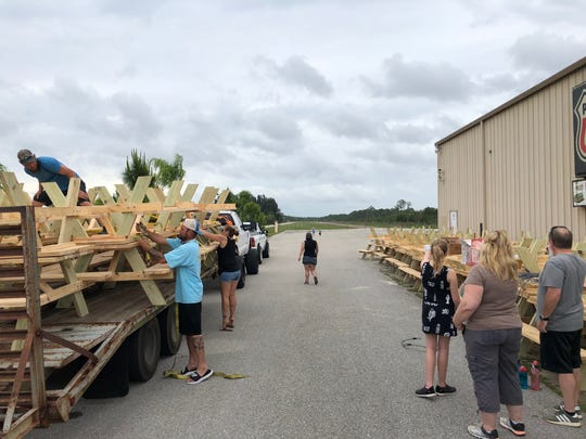 Businesses and area residents helped build 57 picnic tables a response to two deadly hit-and-run crashes, one at a Cape Coral bus stop and one in North Fort Myers, and dropped them off at various sites in Lee County.