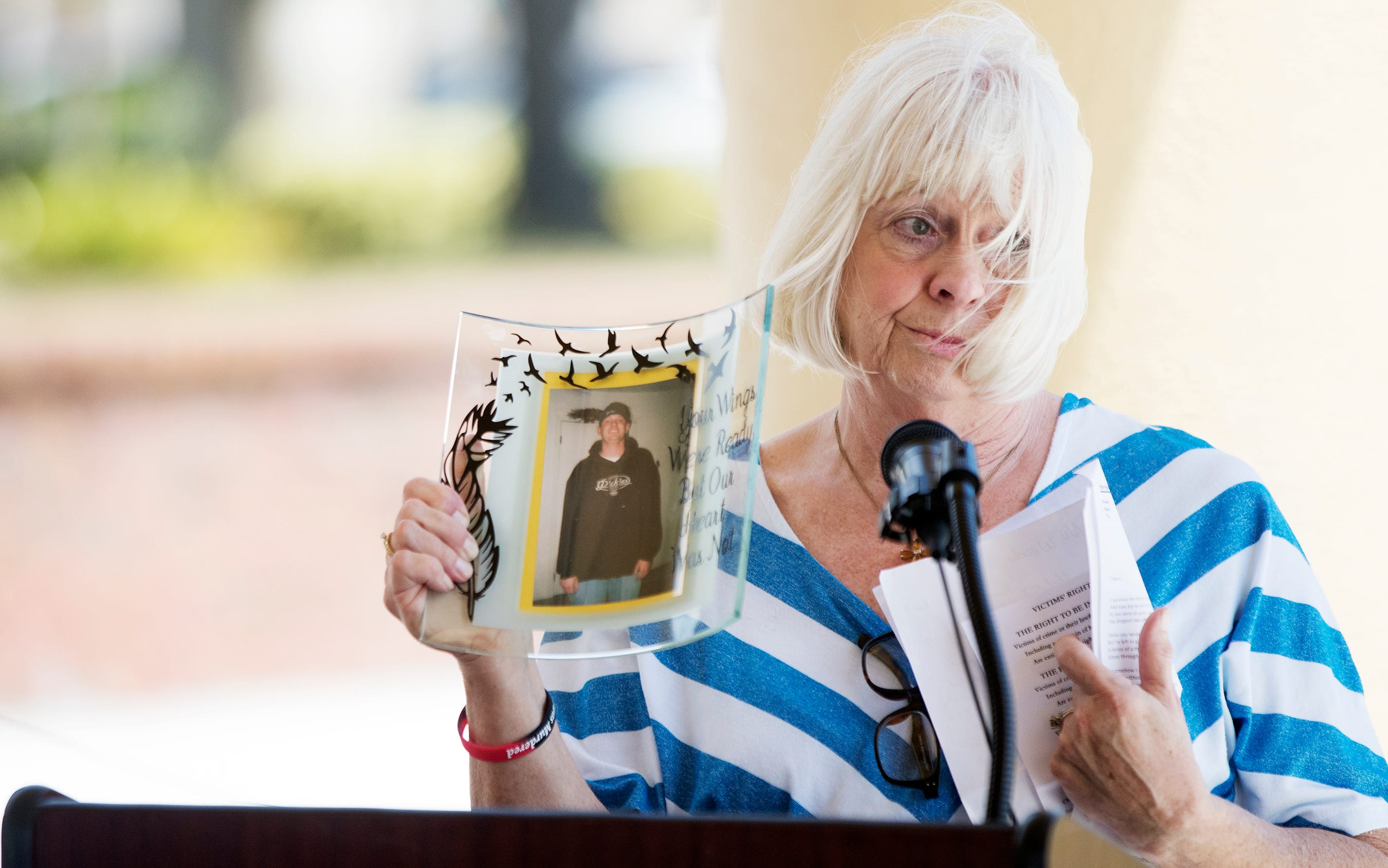 Debbie Harrison honored her son, Joshua Kent, during a National Crime Victims' Rights Week memorial at Centennial Park in downtown Fort Myers on Sunday, Feb. 14, 2019. Kent was killed in 2006. The Victims Advocate office of the Fort Myers Police Department presented the event. Relatives of the victims shared memories of their loved ones.