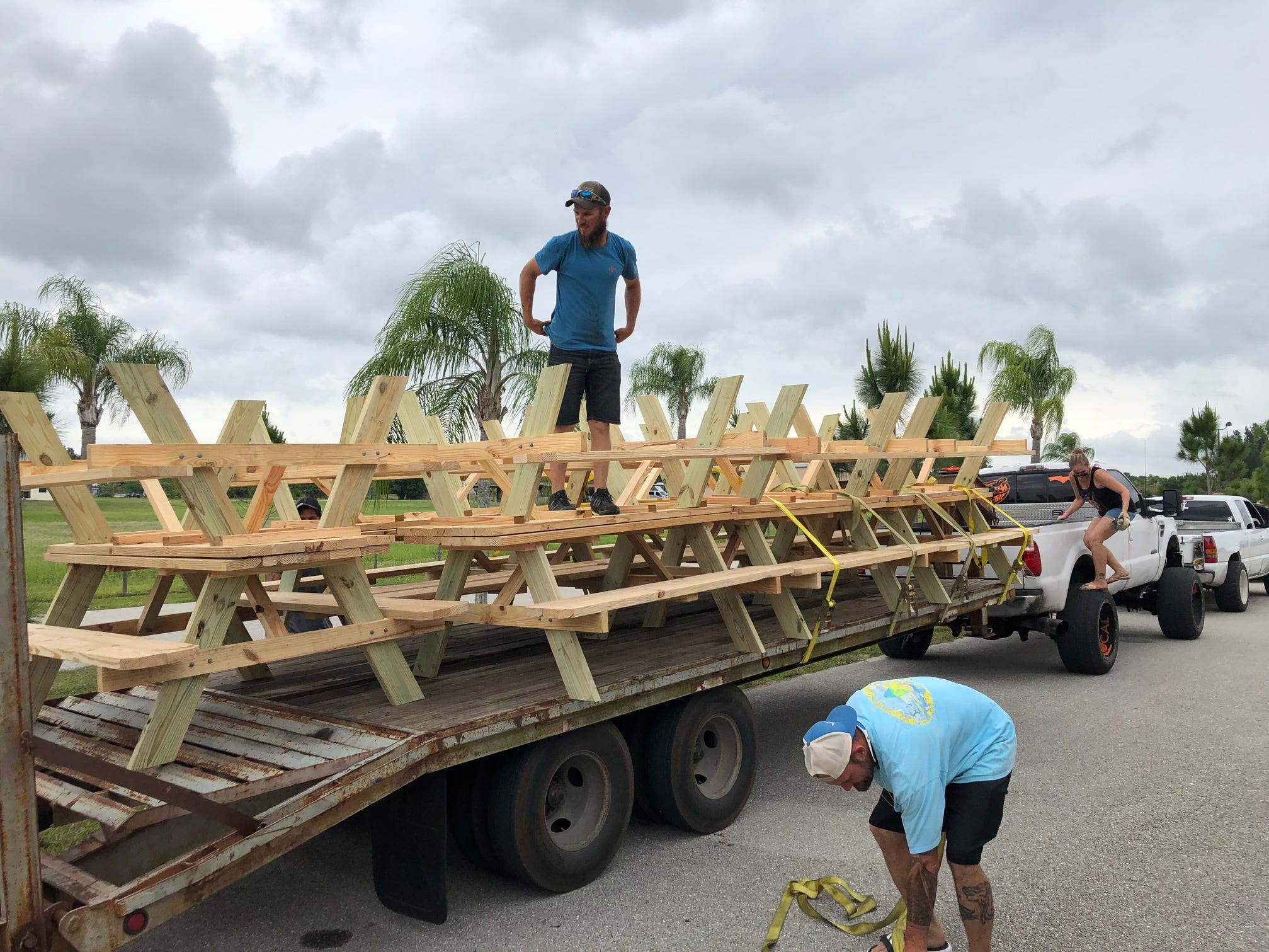 Businesses and area residents helped build 57 Picnic tables Saturday, a response to two deadly hit-and-run crashes, one at a Cape Coral bus stop and one  in North Fort Myers, and dropped them off at various sites in Lee County Sunday.