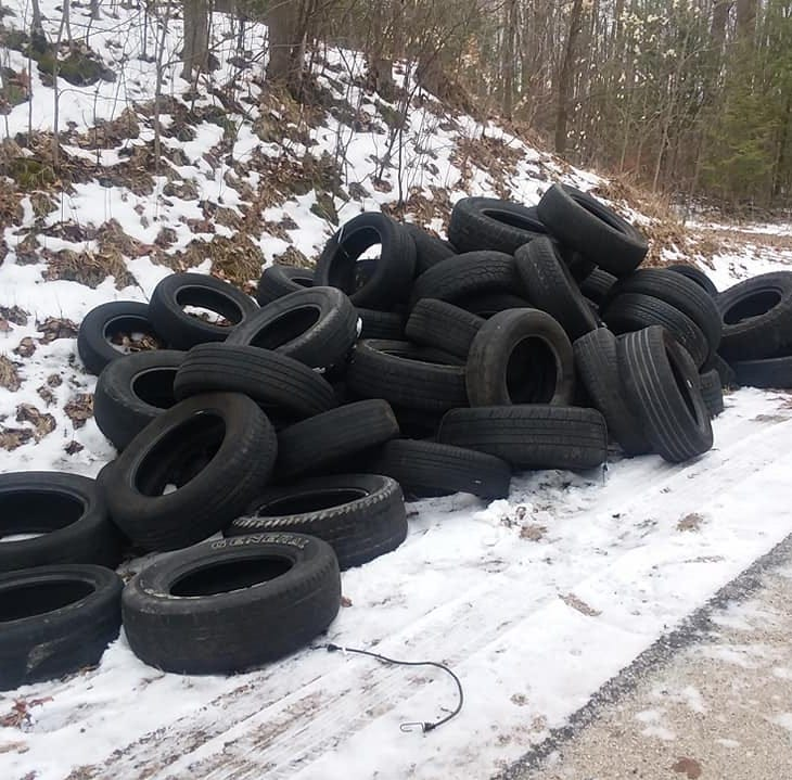 Kewaunee County Sheriff's Department investigating dozens of tires dumped on Gasche Road