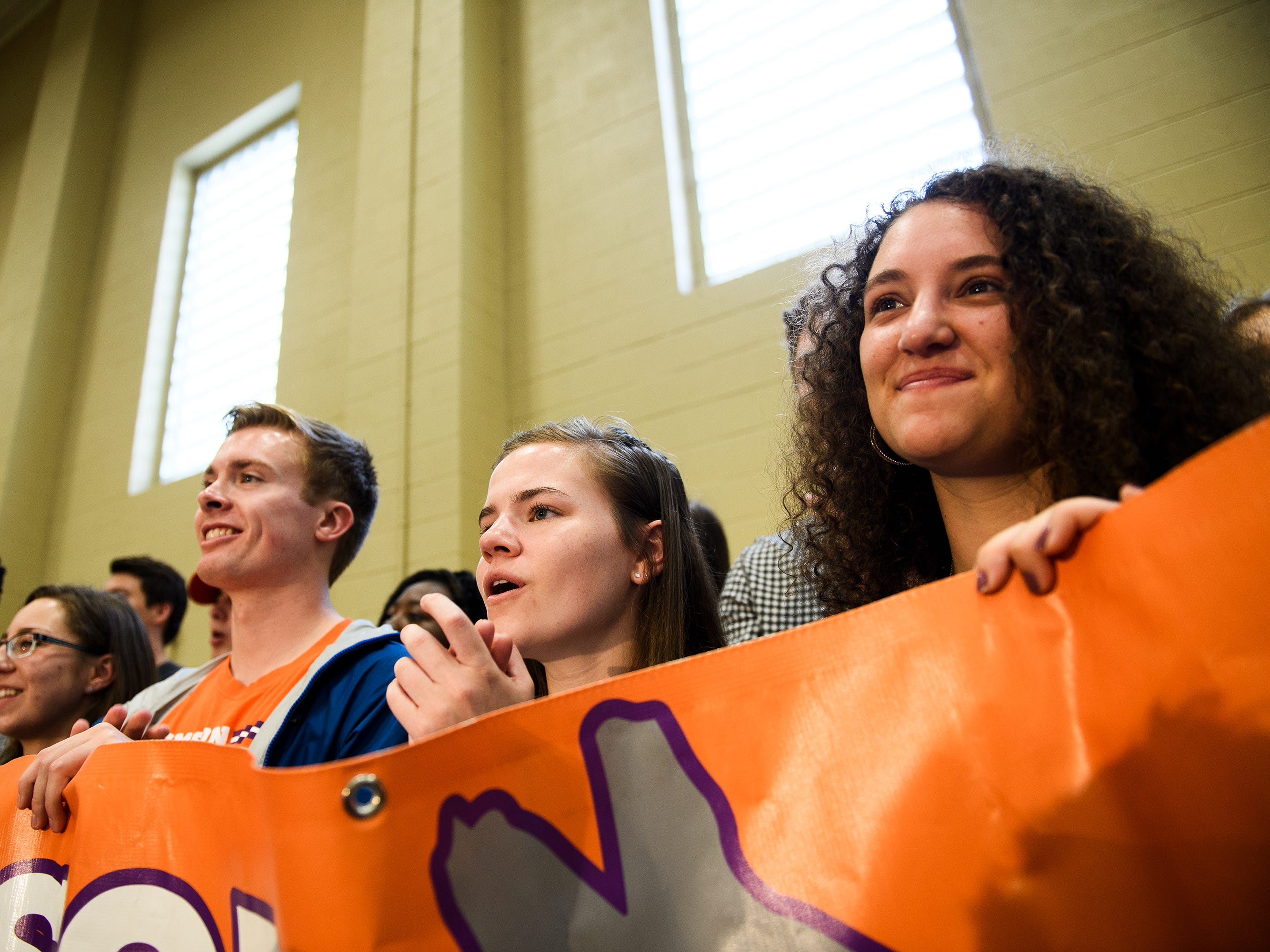 Jessie Osher, right, Emma Ressler and Dylan Erikson list as democratic presidential hopeful Beto O'Rourke speaks at a rally at Clemson University's Five Recreation Center Sunday, April 14, 2019.