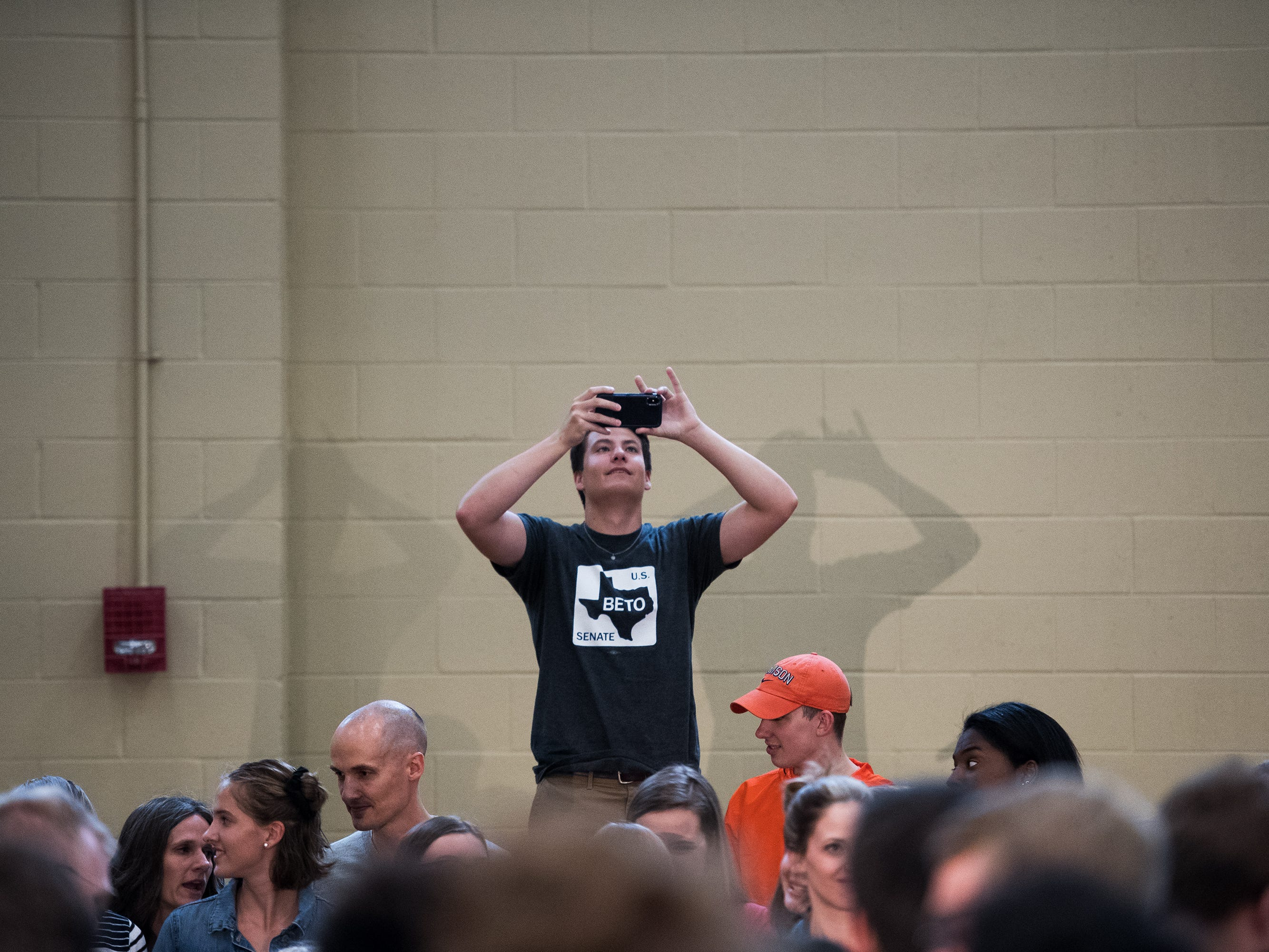 Matthew Jordan, 19, takes a photo of the crowd before democratic presidential hopeful Beto O'Rourke speaks at a rally at Clemson University's Five Recreation Center Sunday, April 14, 2019.