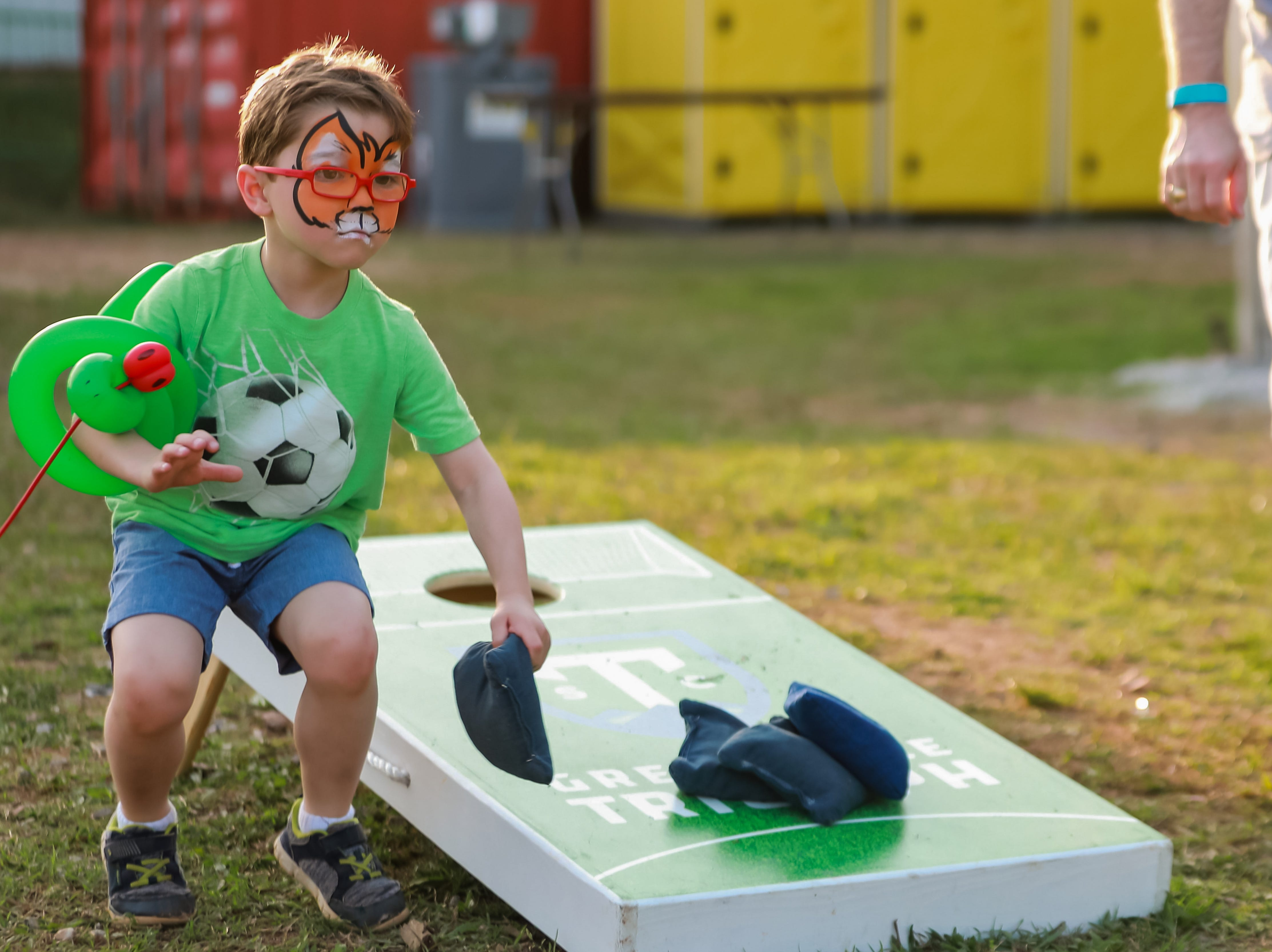 Joshua Biencowe, 6, plays a little corn hole ahead of Greenville Triumph Soccer Club's second home game at Legacy Early College on April 13 at 7 p.m. against the Chattanooga Red Wolves. This is the team's inaugural season.