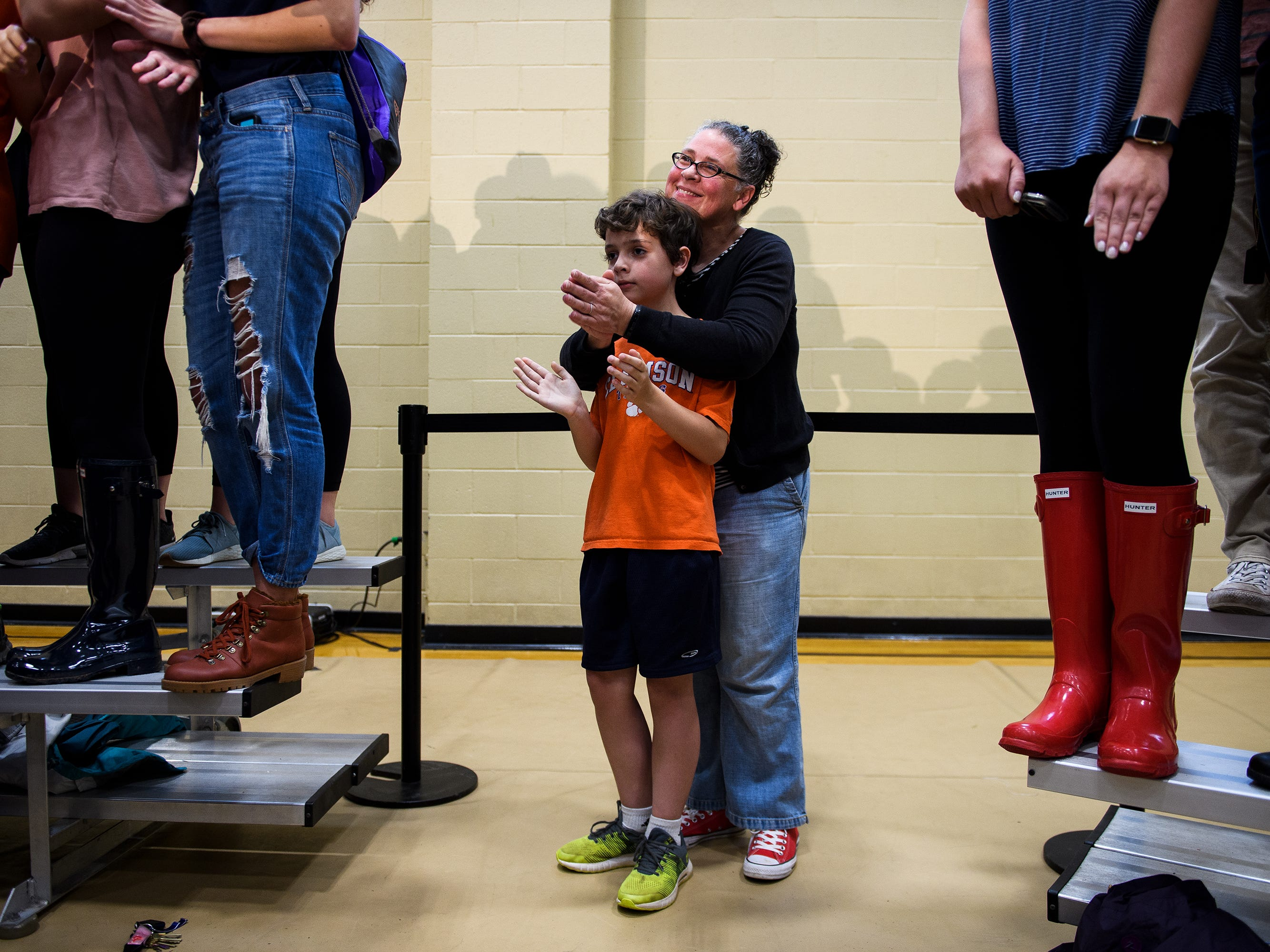 Meghan Mullaney of Clemson and her son Henry Mulholland, 9, list to democratic presidential hopeful Beto O'Rourke speak at a rally at Clemson University's Five Recreation Center Sunday, April 14, 2019.
