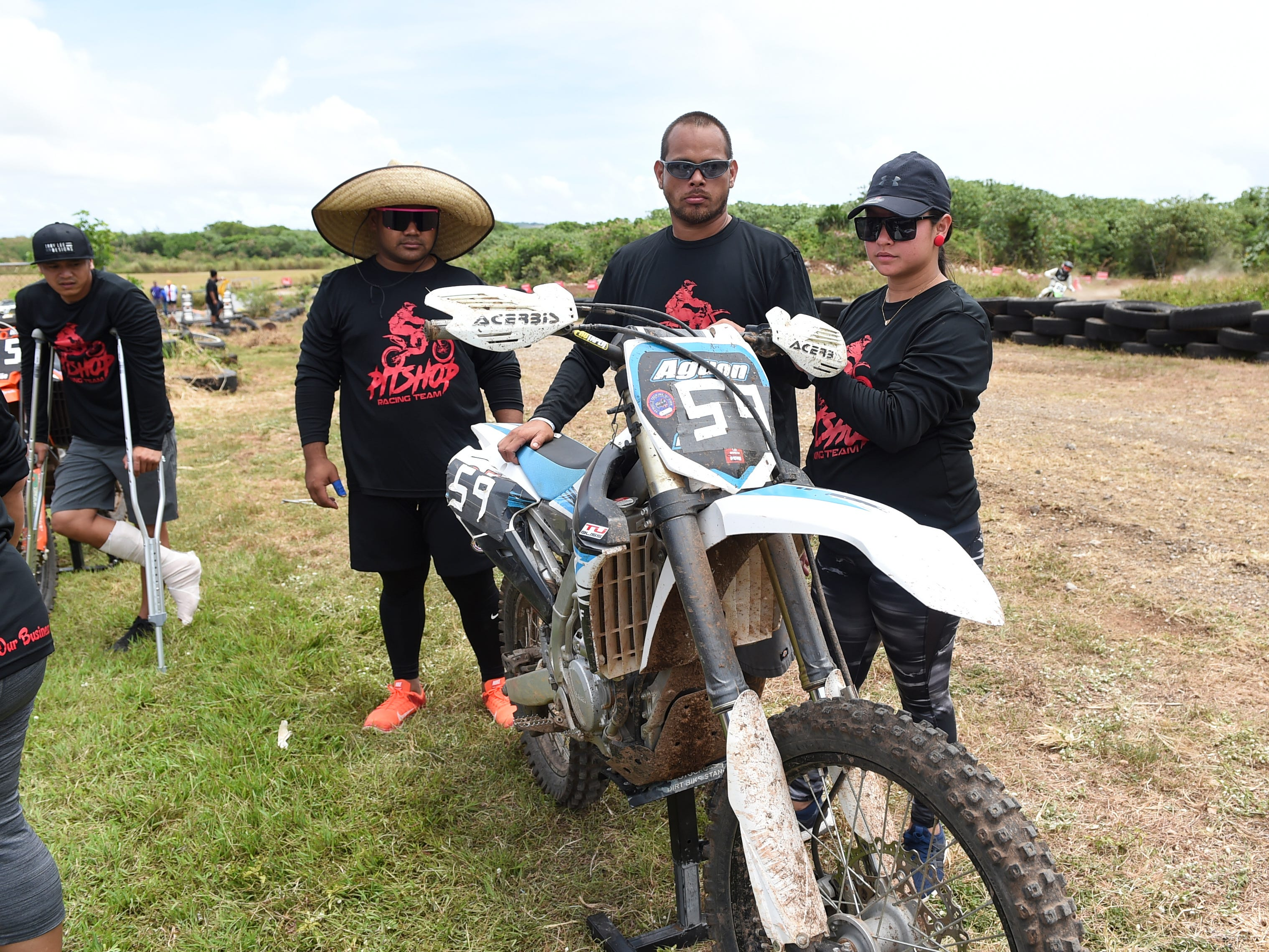 The Pitshop Racing Team crew makes adjustments on their motorcycle during the 39th Annual APL Smokin' Wheels at the Guam International Raceway in Yigo, April 14, 2019.