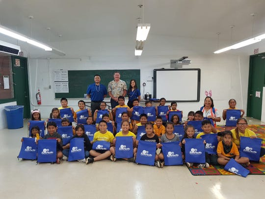 BankPacific employees delivered interactive and educational presentations to public school children at Maria Ulloa Elementary April 12. Standing from left, BankPacific's Ernesto Miranda, Philip Flores and Elisha Elisha Escalera.