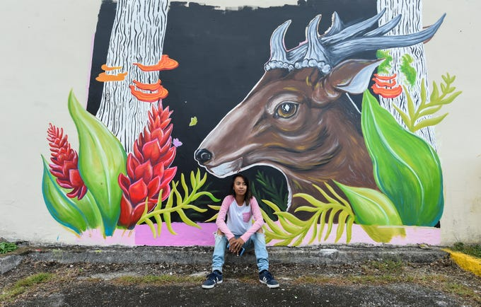 Lucille Ronquillo, a University of Guam graduate, at her mural in progress for the GAX POW!WOW! Guam series in Hagåtña on April 14, 2019.