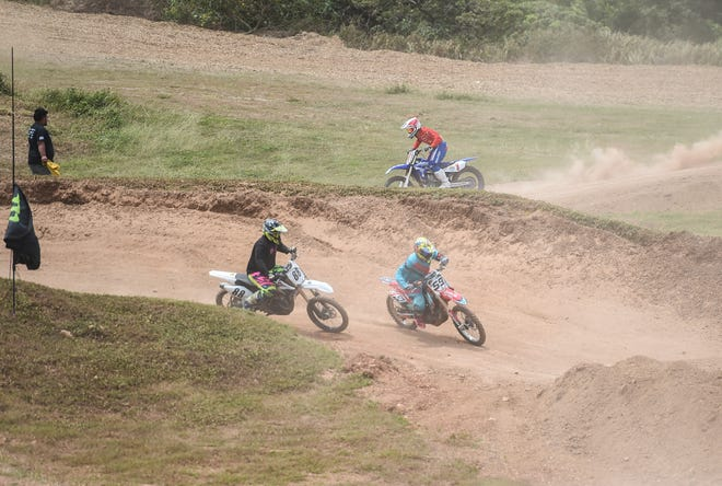 Motocross racers compete in a two-hour big bikes enduro run during the 39th Annual APL Smokin' Wheels at the Guam International Raceway in Yigo, April 14, 2019.