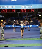 Women's marathon competitor Tomomi Sawahata finishes first with a time of 3 hours, 1 minute and 8 seconds in the United Airlines Guam Marathon in Tumon.