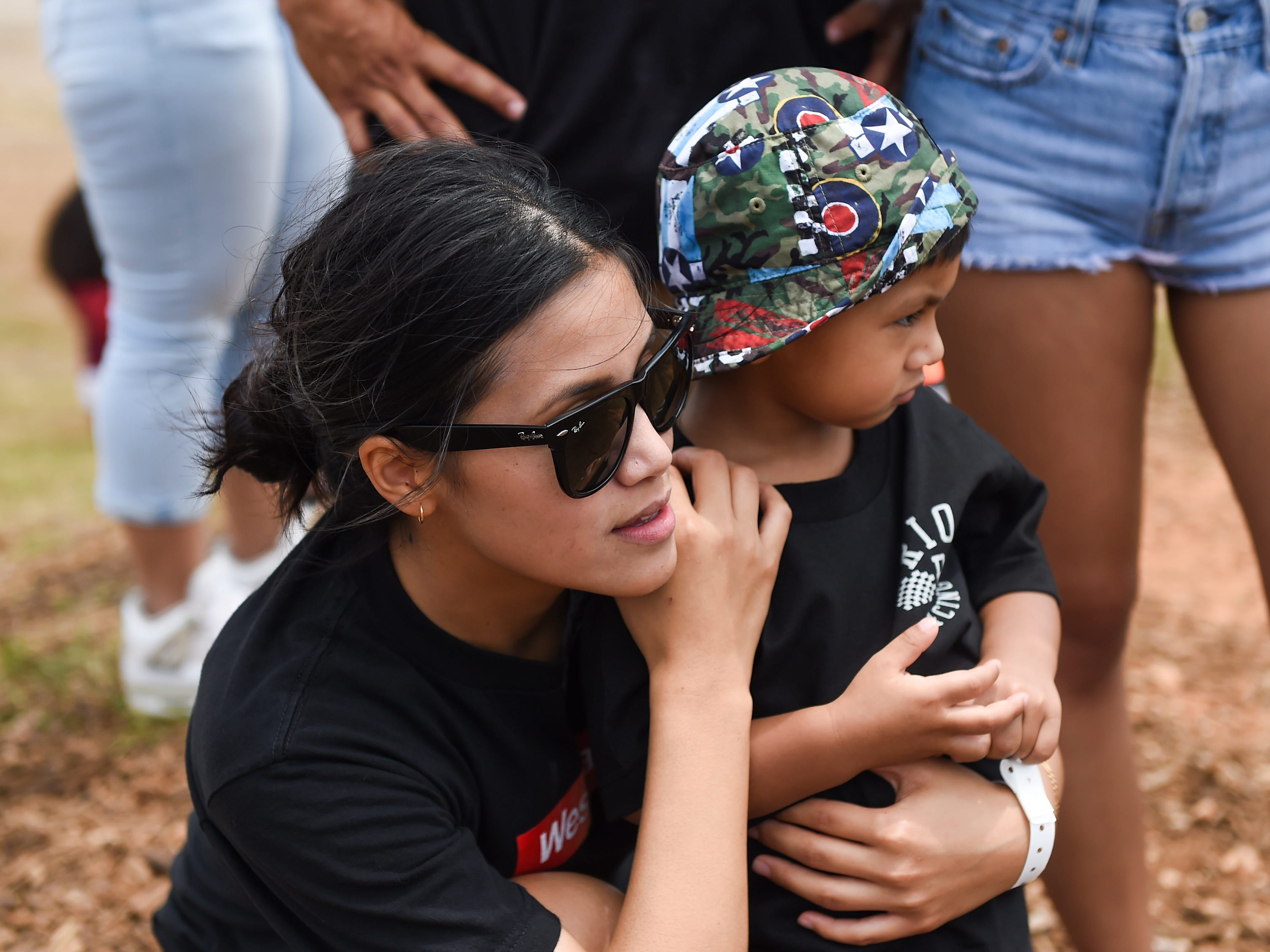 Jonnie Tavares and her son Mateus Tavares, 2, show support for motocross competitor Frank Rios during the 39th Annual APL Smokin' Wheels at the Guam International Raceway in Yigo, April 14, 2019.