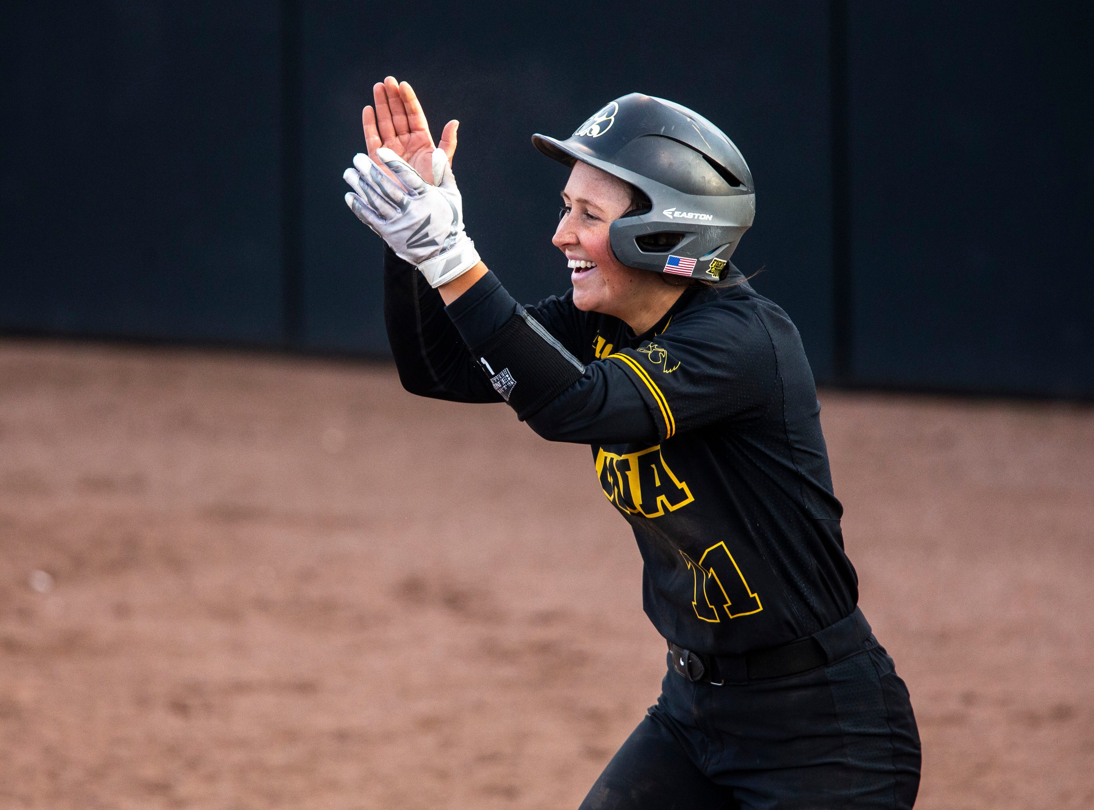 Iowa pitcher Mallory Killian (11) celebrates after scoring a run during a NCAA Big Ten Conference softball game on Saturday, April 13, 2019, at Bob Pearl Field in Coralville, Iowa. The Hawkeyes defeated Illinois, 4-3, for the first home win of the season.