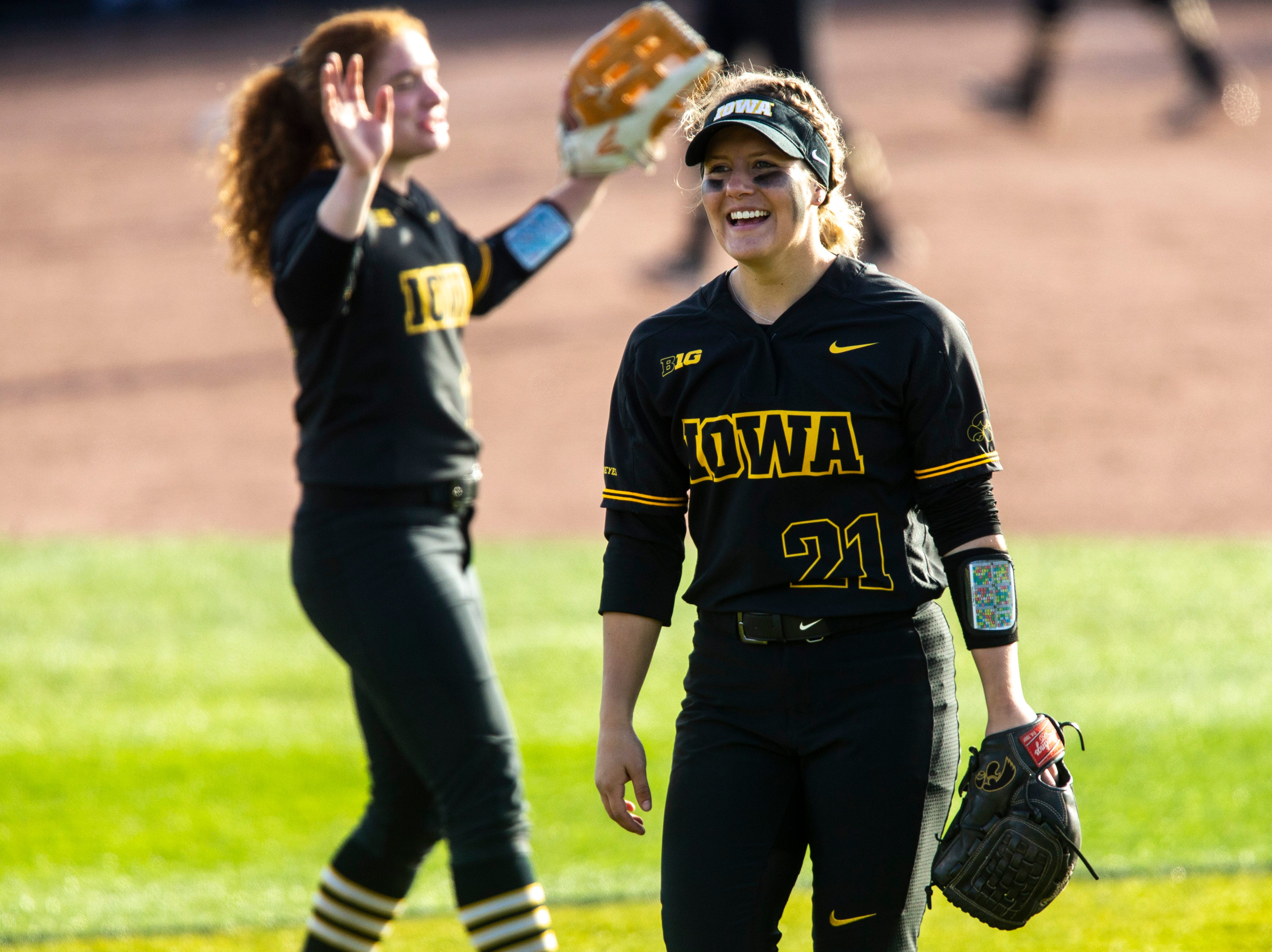 Iowa outfielder Havyn Monteer (21) smiles in between innings during a NCAA Big Ten Conference softball game on Saturday, April 13, 2019, at Bob Pearl Field in Coralville, Iowa.
