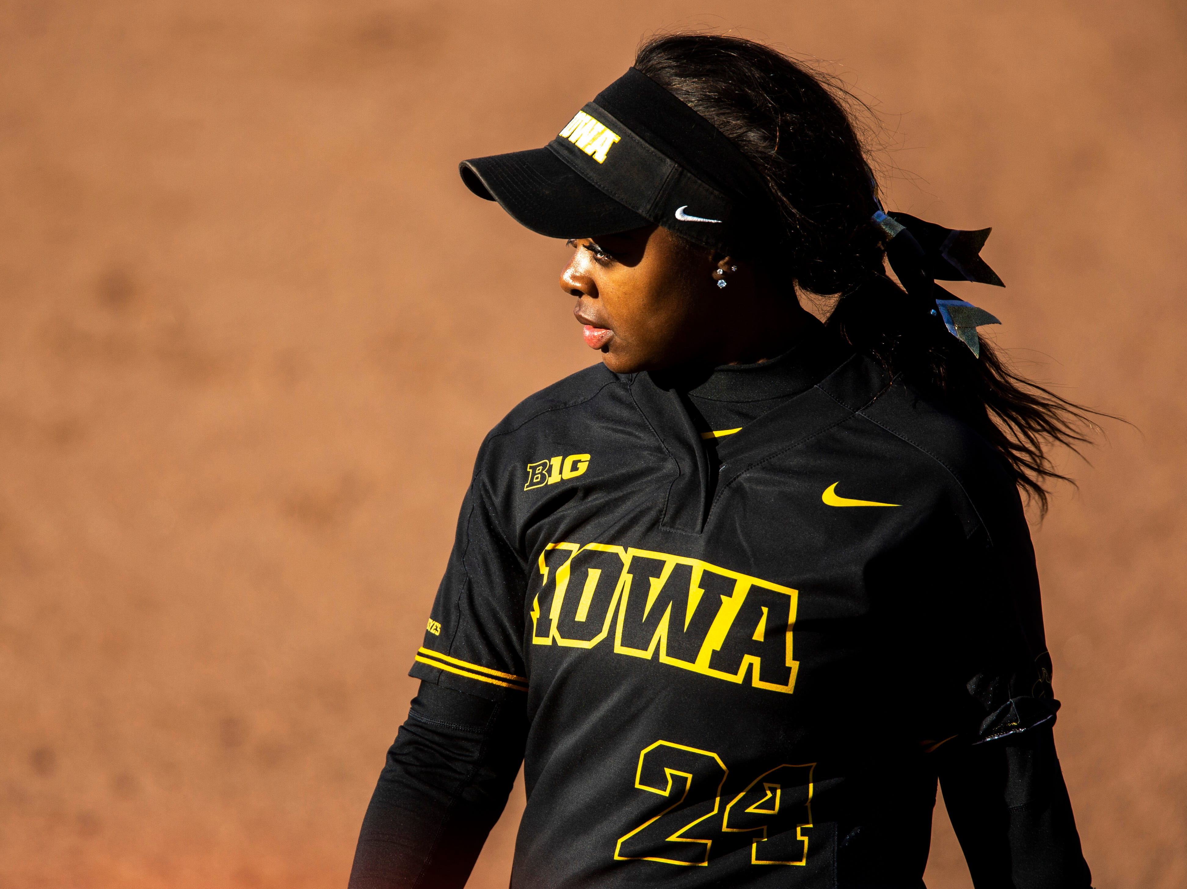 Iowa's DoniRae Mayhew (24) stands at first during a NCAA Big Ten Conference softball game on Saturday, April 13, 2019, at Bob Pearl Field in Coralville, Iowa.
