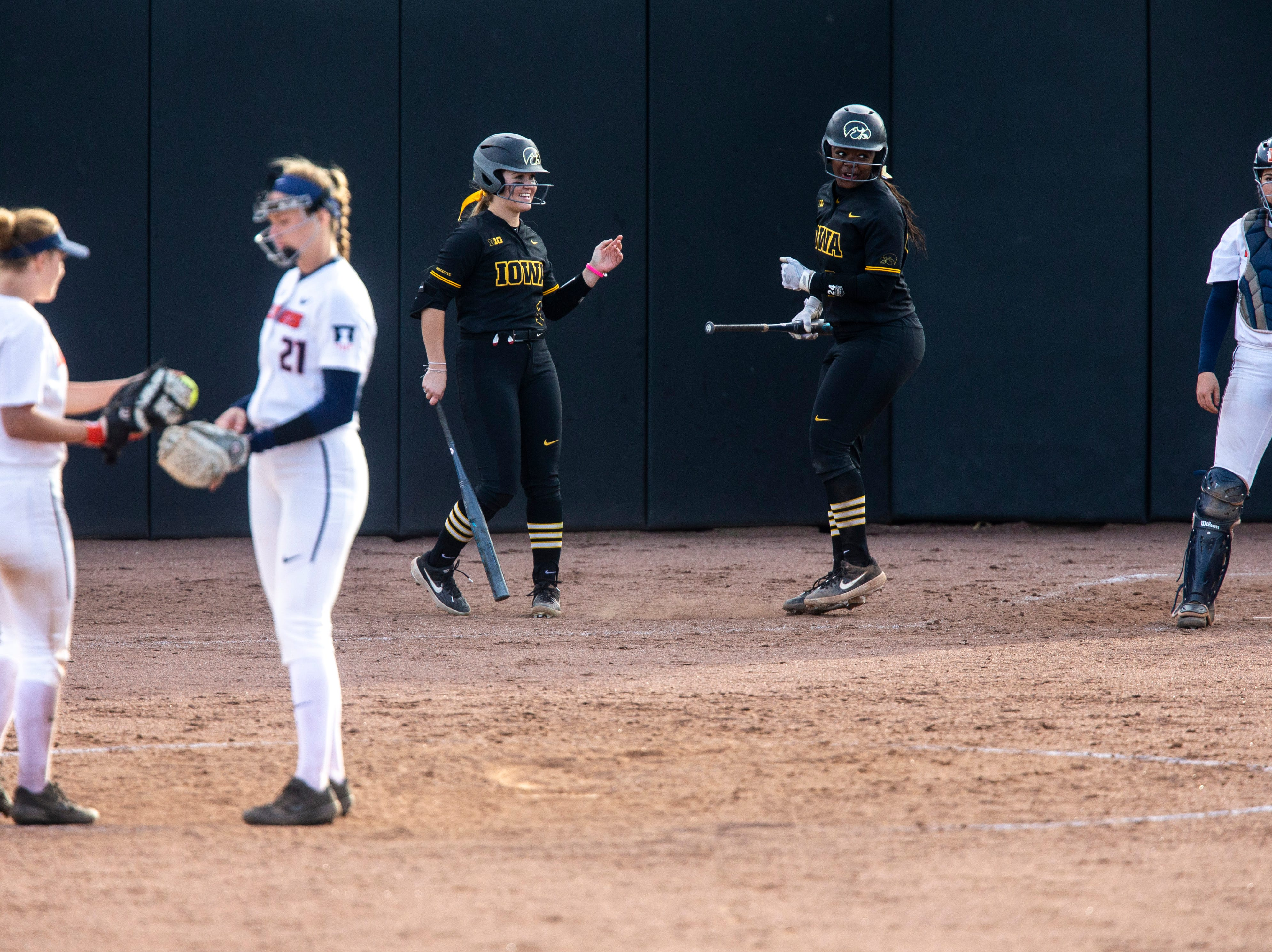 Iowa's DoniRae Mayhew (24) celebrates after getting a run during a NCAA Big Ten Conference softball game on Saturday, April 13, 2019, at Bob Pearl Field in Coralville, Iowa.