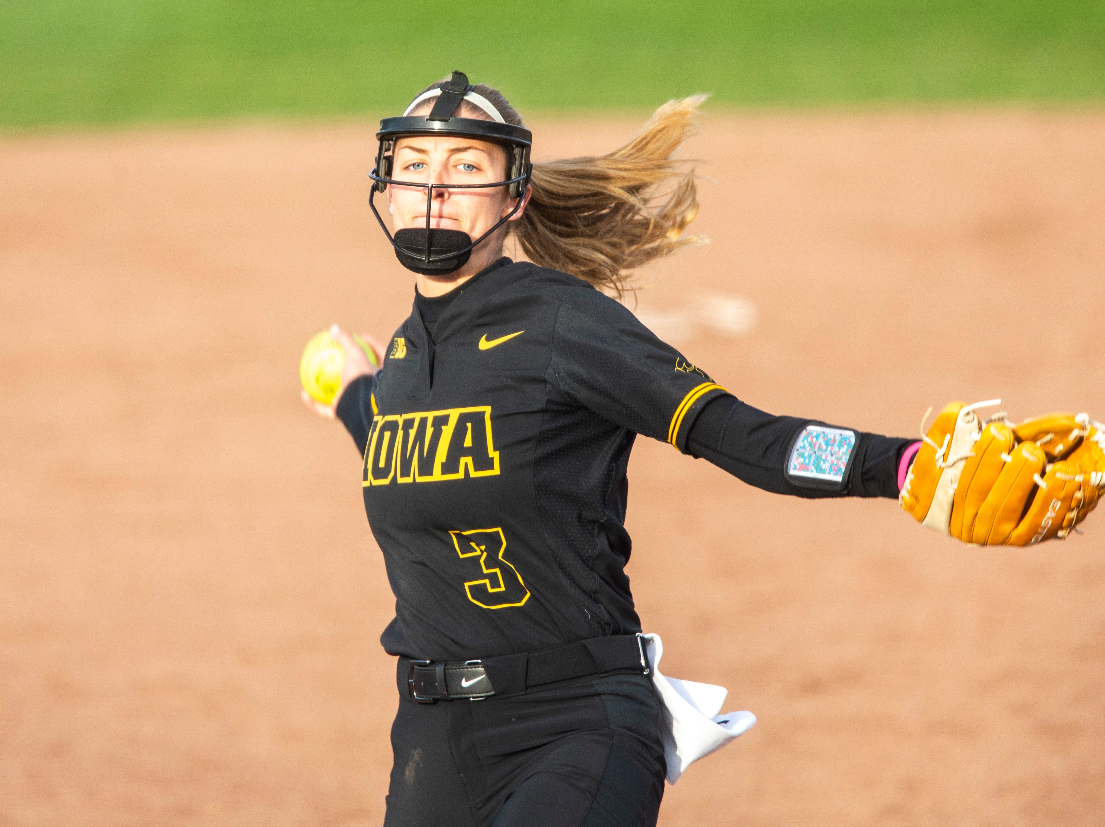Iowa's Allison Doocy (3) delivers a pitch during a NCAA Big Ten Conference softball game on Saturday, April 13, 2019, at Bob Pearl Field in Coralville, Iowa.