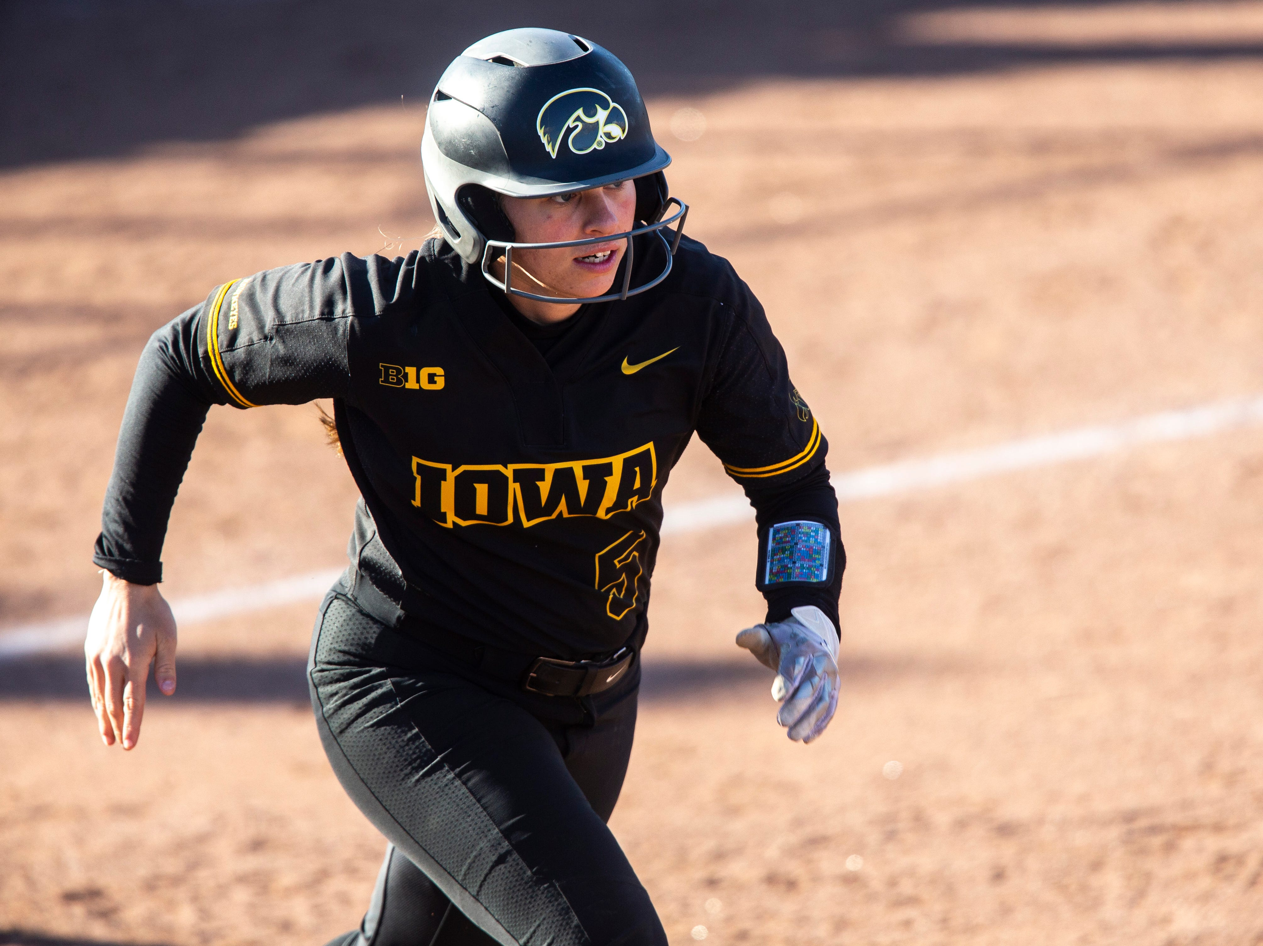Iowa infielder Sydney Owens (5) runs to first during a NCAA Big Ten Conference softball game on Saturday, April 13, 2019, at Bob Pearl Field in Coralville, Iowa.