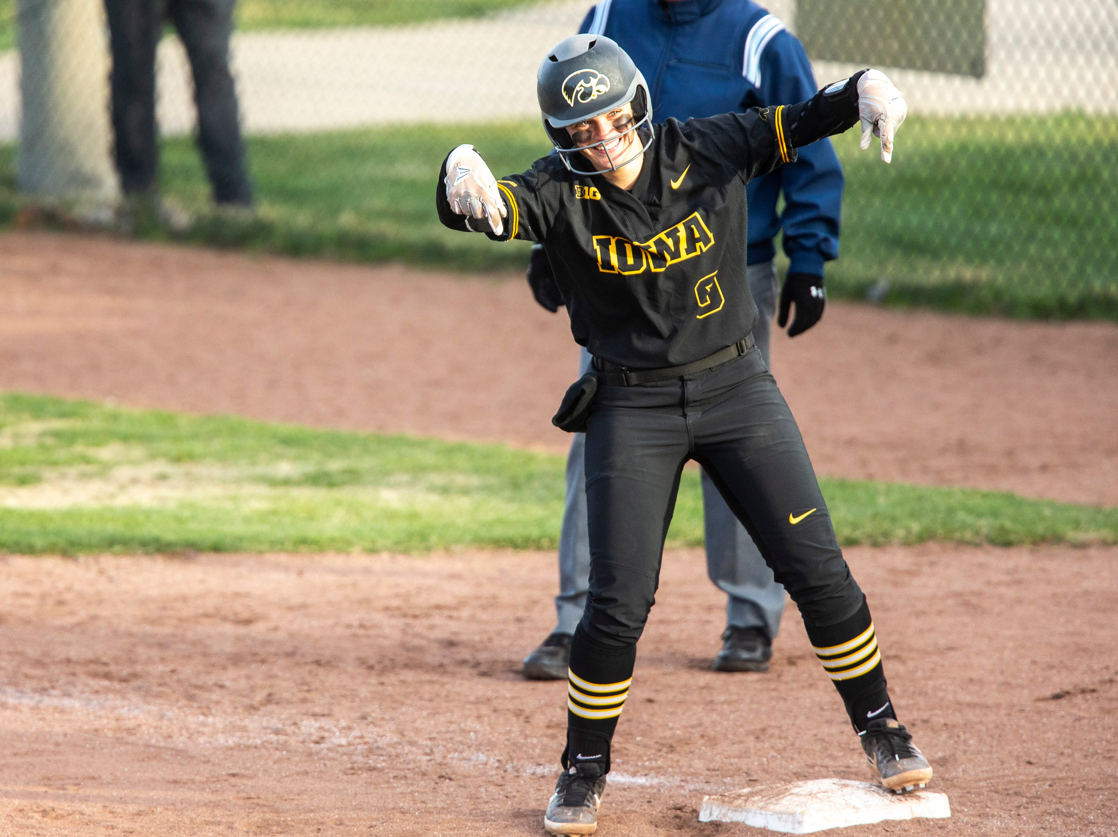 Iowa catcher Abby Lien (9) celebrates after getting on base during a NCAA Big Ten Conference softball game on Saturday, April 13, 2019, at Bob Pearl Field in Coralville, Iowa.