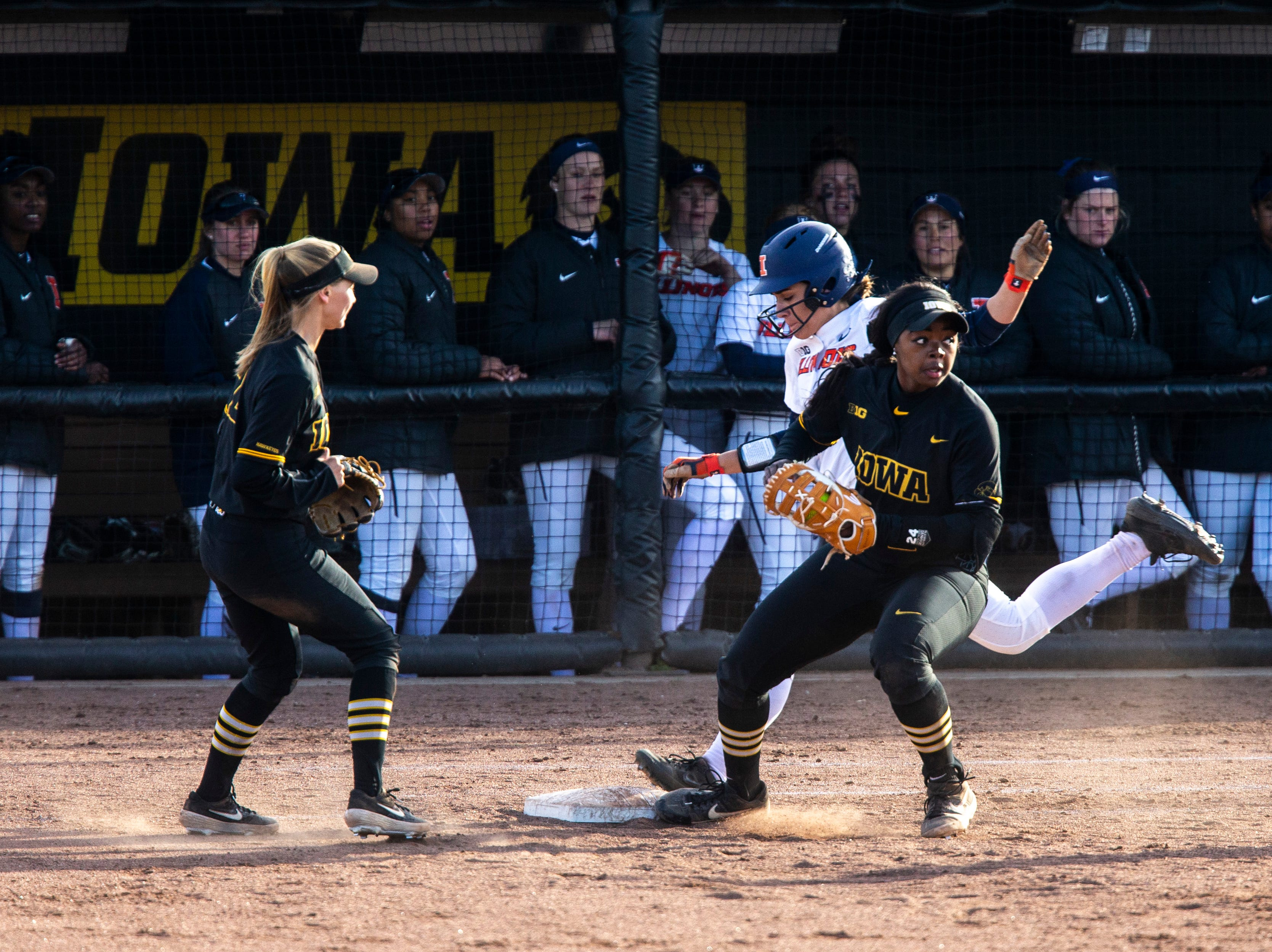 Iowa's DoniRae Mayhew (24) gets an out at first during a NCAA Big Ten Conference softball game on Saturday, April 13, 2019, at Bob Pearl Field in Coralville, Iowa.