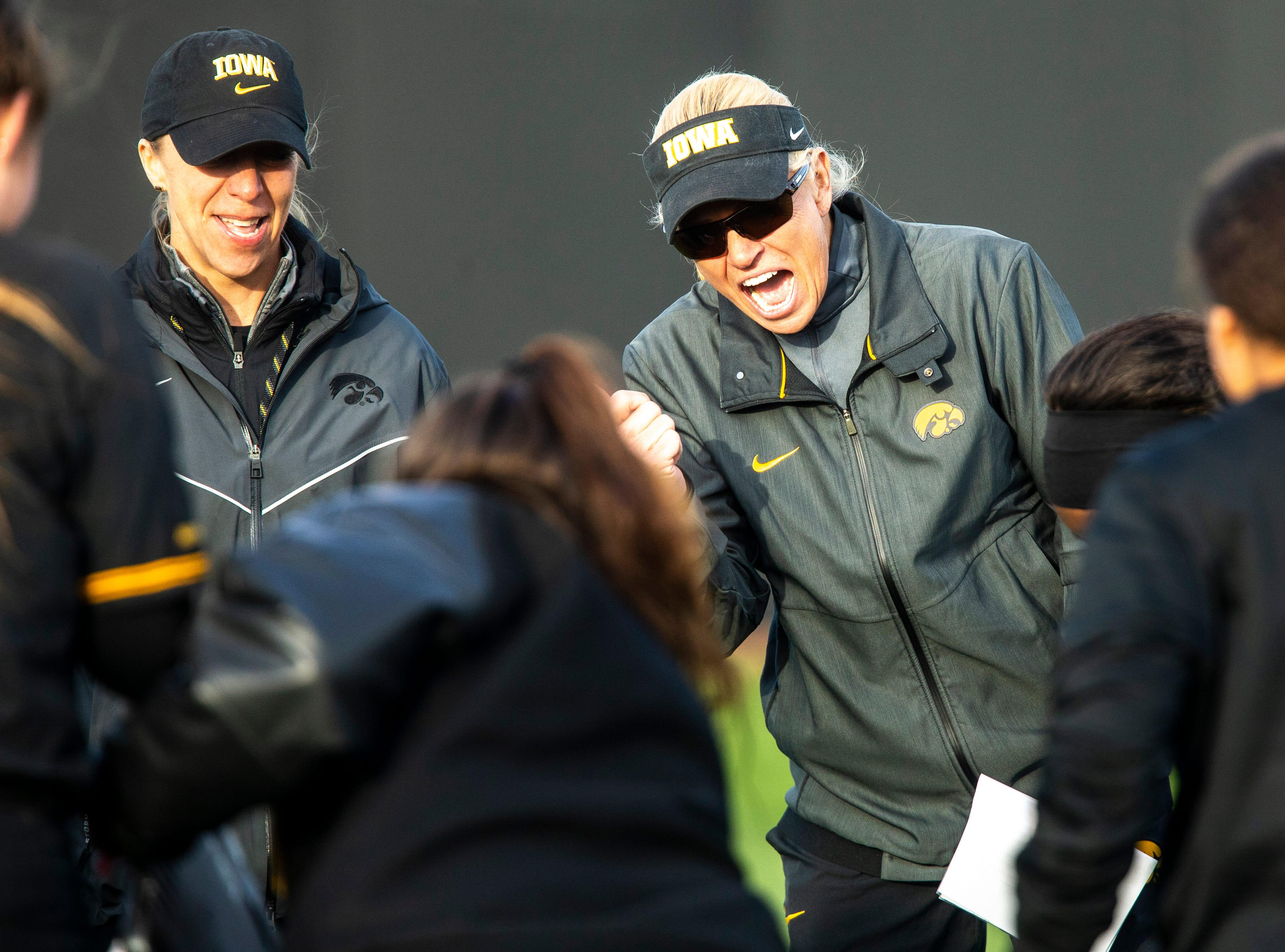 Iowa head coach Renee Gillispie celebrates with the team after a NCAA Big Ten Conference softball game against Illinois on Saturday, April 13, 2019, at Bob Pearl Field in Coralville, Iowa. The Hawkeyes defeated Illinois, 4-3, for the first home win of the season.