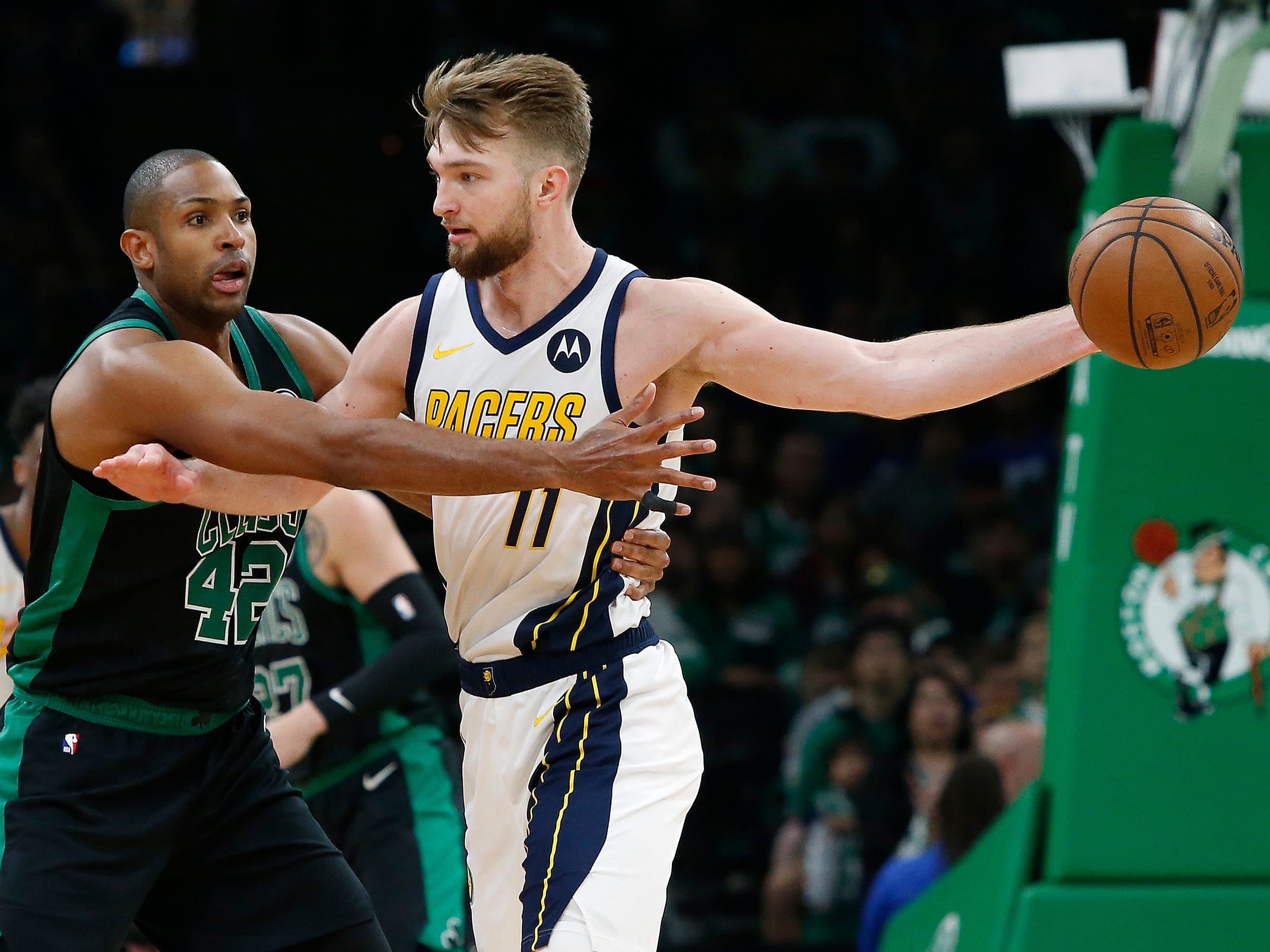 Indiana Pacers' Domantas Sabonis holds the ball away from Boston Celtics' Al Horford during the second quarter in Game 1 of a first-round NBA basketball playoff series, Sunday, April 14, 2019, in Boston.
