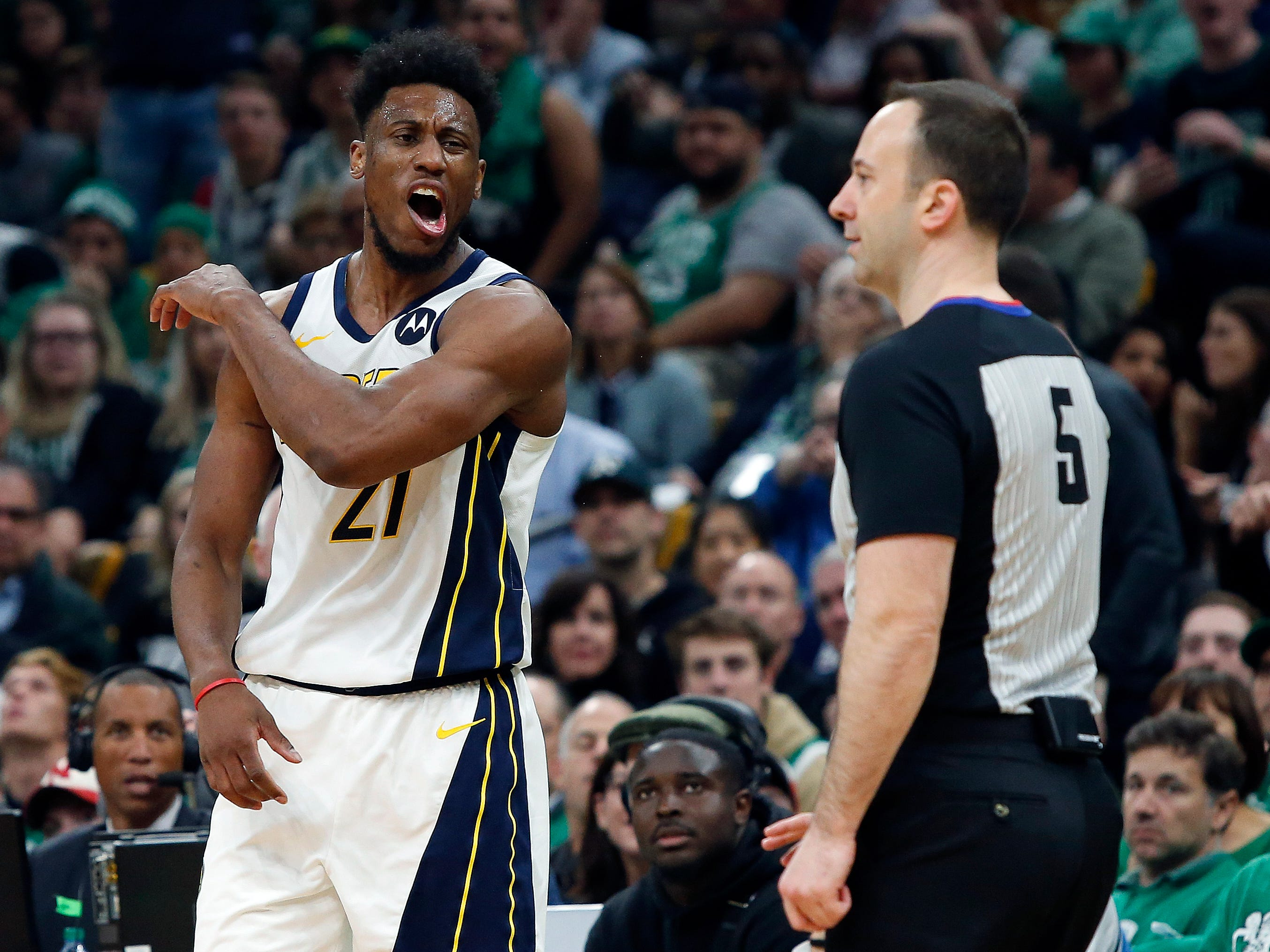 Indiana Pacers' Thaddeus Young reacts to a foul called against him by referee Kane Fitzgerald (5) during the second quarter in Game 1 of a first-round NBA basketball playoff series against the Boston Celtics, Sunday, April 14, 2019, in Boston.