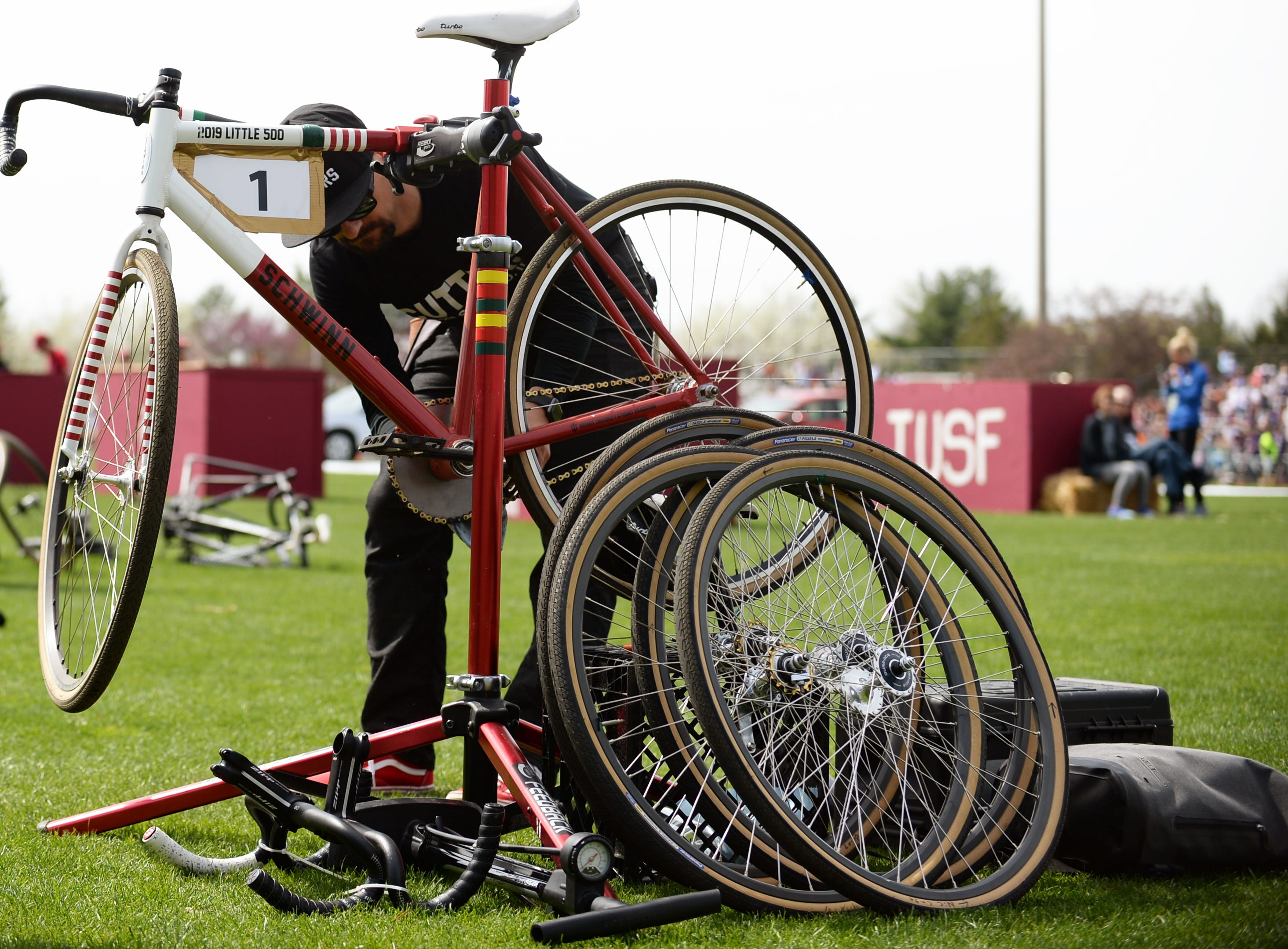 The Cutters mechanic works on a bike during the men's Little 500 at Bill Armstrong Stadium in Bloomington, Ind., on Saturday, April 13, 2019.