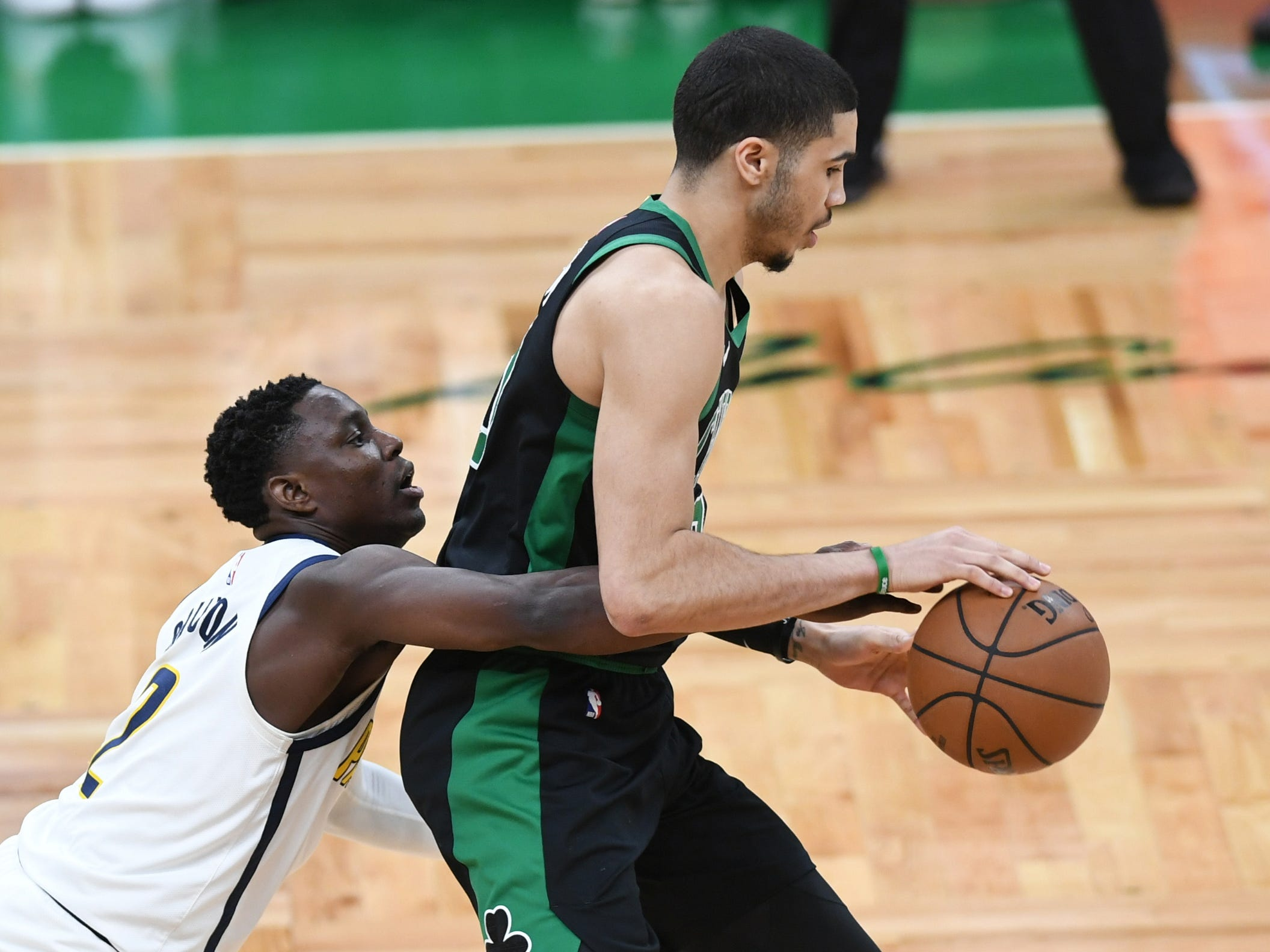 Apr 14, 2019; Boston, MA, USA; Indiana Pacers guard Darren Collison (2) tries to steal the ball from Boston Celtics forward Jayson Tatum (0) during the first half in game one of the first round of the 2019 NBA Playoffs at TD Garden.