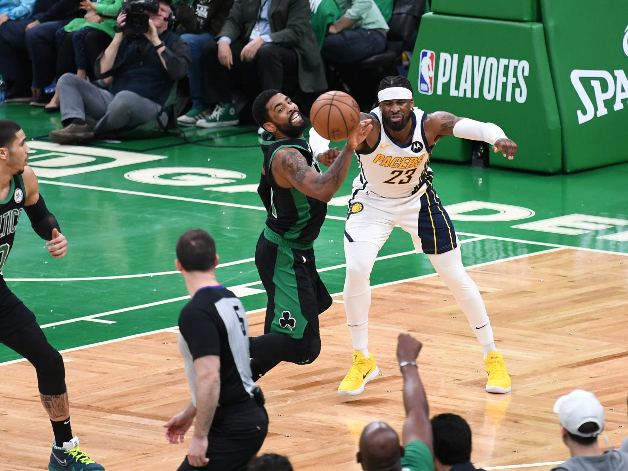Apr 14, 2019; Boston, MA, USA; Boston Celtics guard Kyrie Irving (11) steals the ball from Indiana Pacers guard Wesley Matthews (23) during the first half in game one of the first round of the 2019 NBA Playoffs at TD Garden.