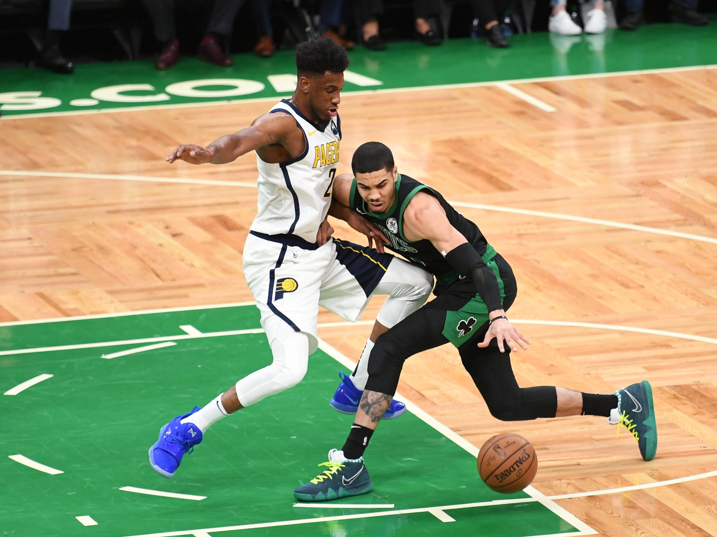 Apr 14, 2019; Boston, MA, USA; Indiana Pacers forward Thaddeus Young (21) defends Boston Celtics forward Jayson Tatum (0) during the first half in game one of the first round of the 2019 NBA Playoffs at TD Garden.